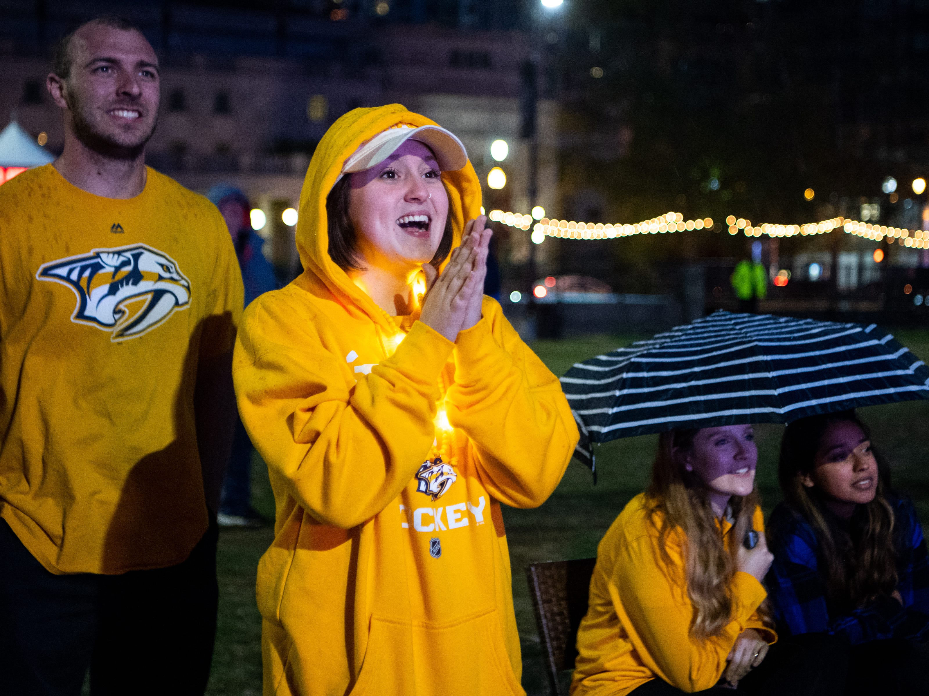 Angie Manning cheers during the third period of the Nashville Predators game against the Dallas Stars at Preds Party in the Park at Walk of Fame Park Saturday, April 13, 2019, in Nashville, Tenn.