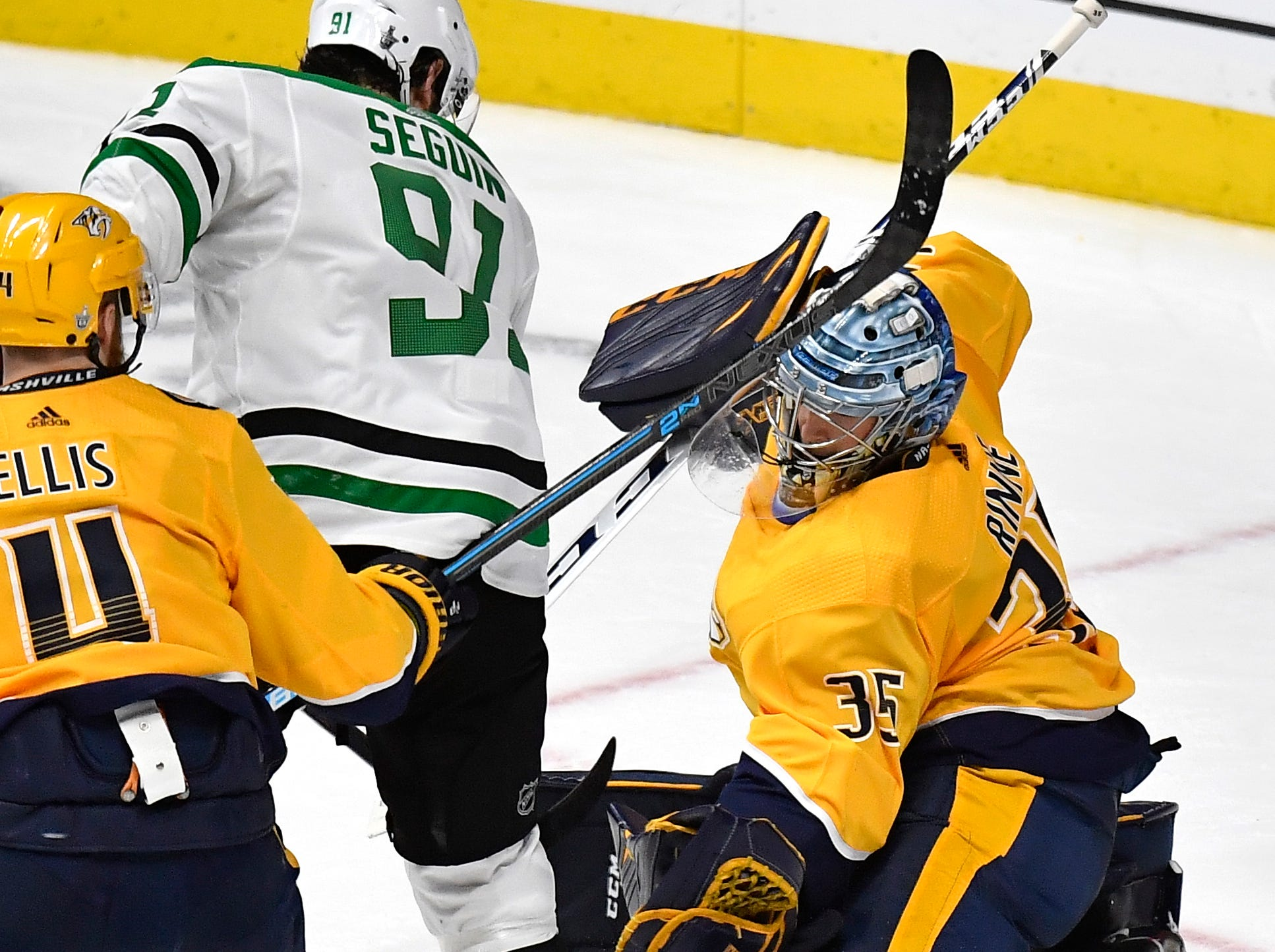 Nashville Predators goaltender Pekka Rinne (35) stops the puck as Dallas Stars center Tyler Seguin (91) closes in during the second period of the divisional semifinal game at Bridgestone Arena in Nashville, Tenn., Saturday, April 13, 2019.