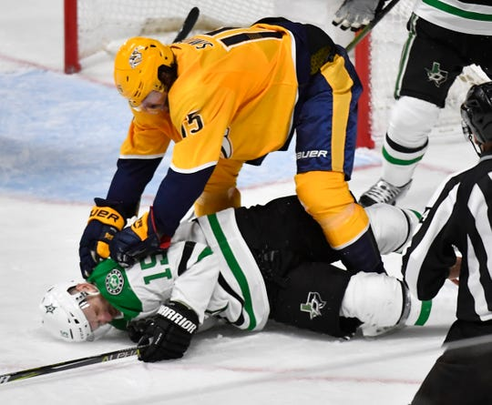 Predators right wing Craig Smith (15) pounds Stars left wing Blake Comeau (15) during the third period of Game 2 on Saturday.