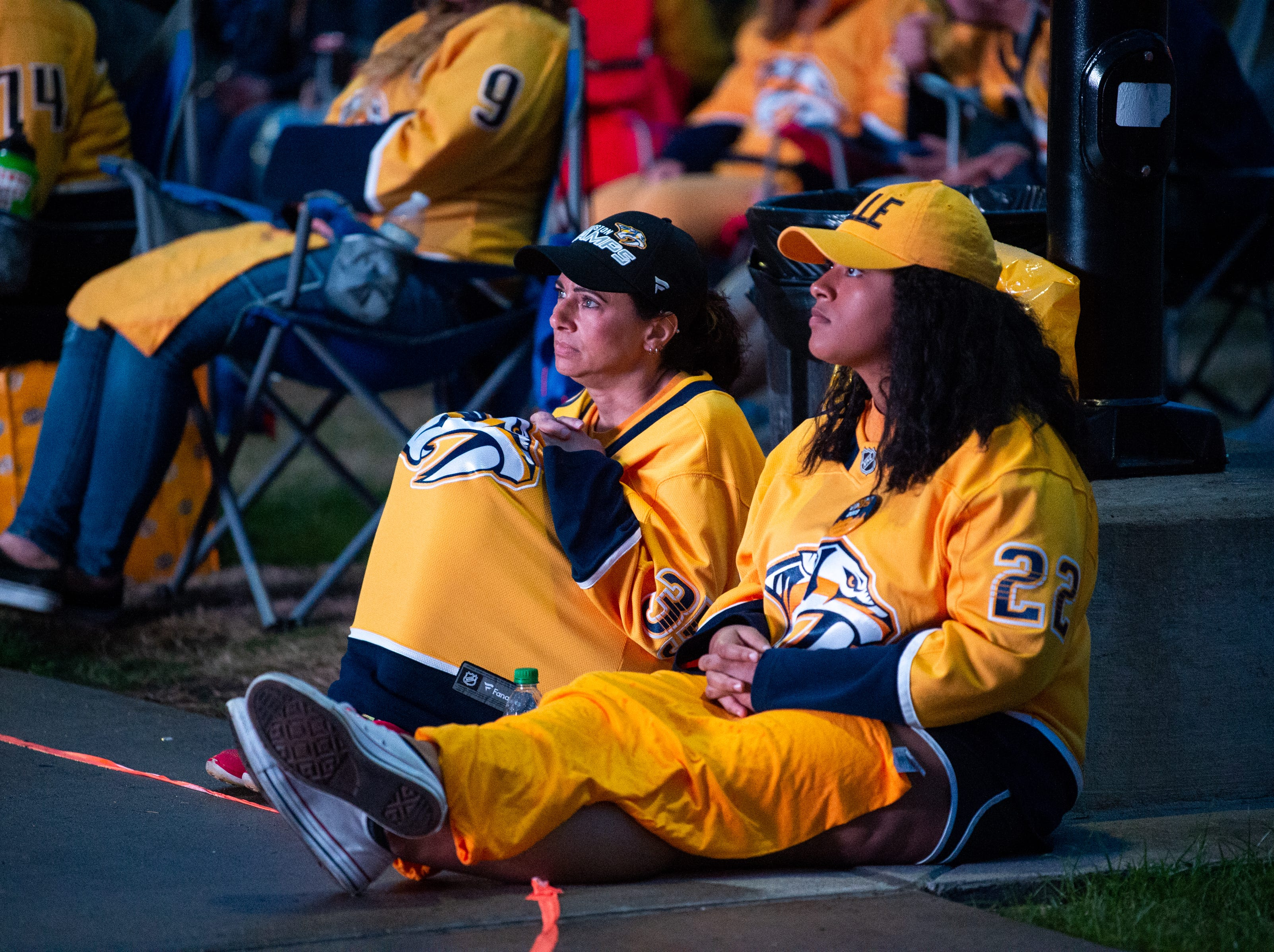 Fans watch the third period of the Nashville Predators game against the Dallas Stars at Preds Party in the Park at Walk of Fame Park Saturday, April 13, 2019, in Nashville, Tenn.