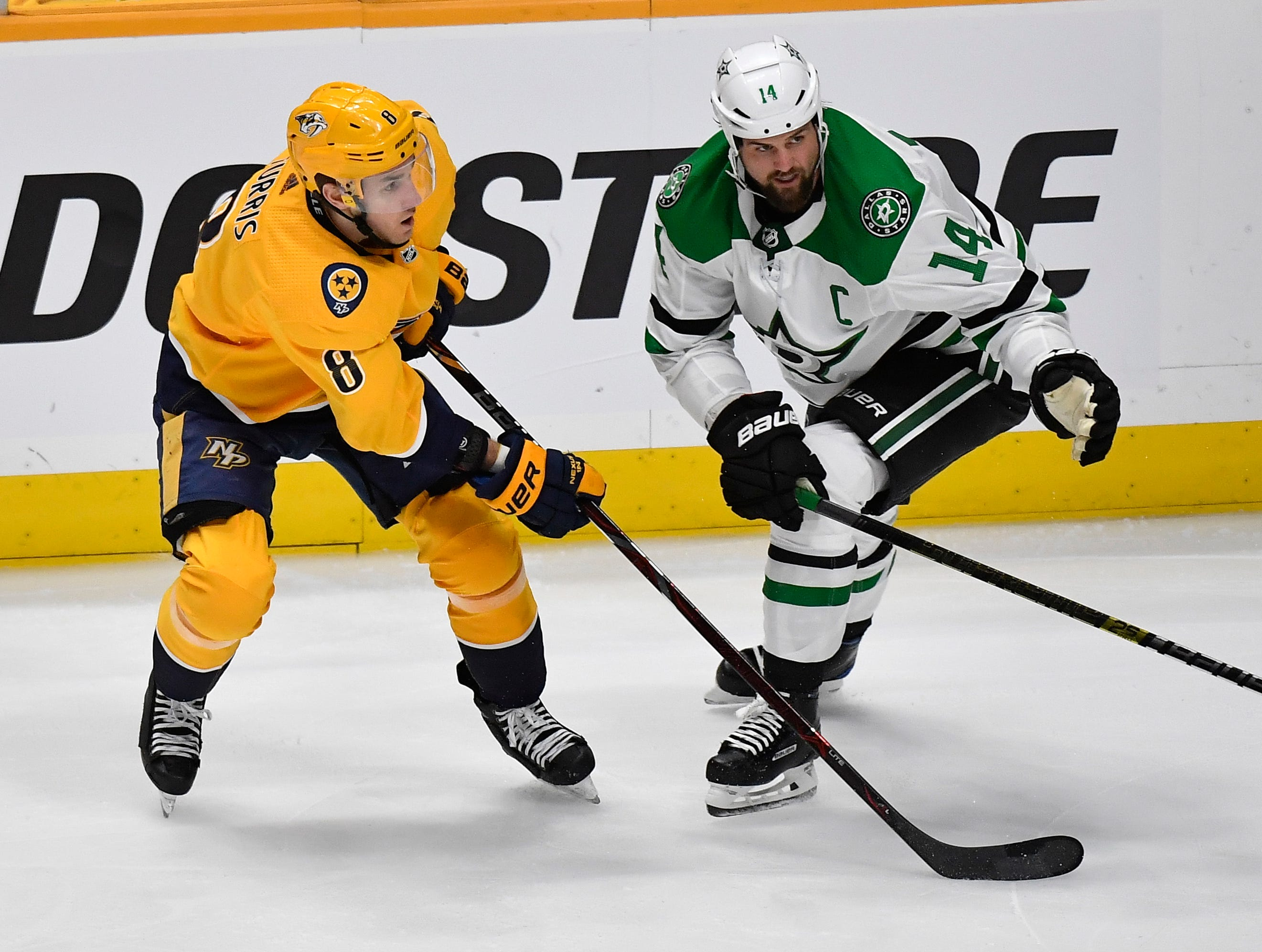 Nashville Predators center Kyle Turris (8) and Dallas Stars left wing Jamie Benn (14) battle for the puck during the third period of the divisional semifinal game at Bridgestone Arena in Nashville, Tenn., Saturday, April 13, 2019.