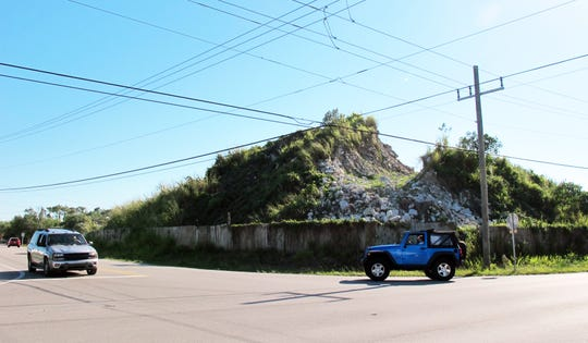 The mountain of concrete and debris on the southwest corner of Industrial Boulevard and Mercantile Avenue in East Naples is part of the Cadenhead family's recycling business.