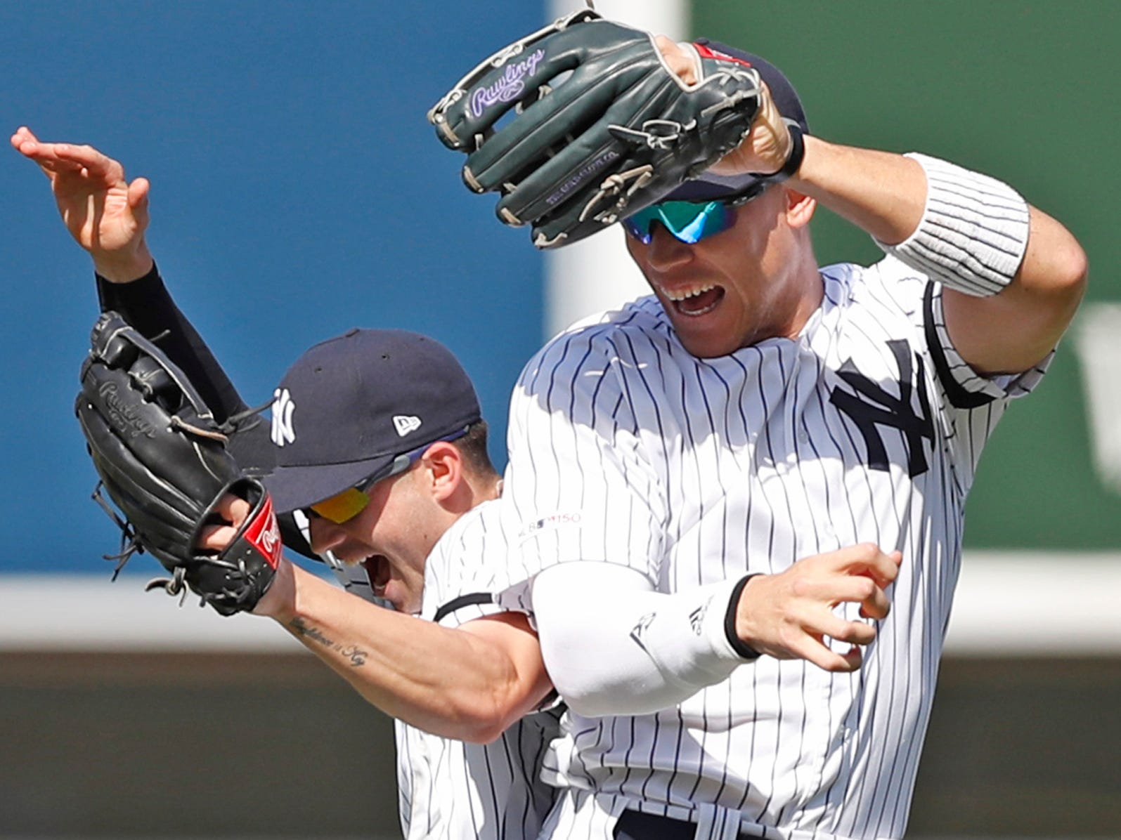 New York Yankees second baseman Tyler Wade, left, celebrates with right fielder Aaron Judge after the Yankees defeated the Chicago White Sox 4-0 in a baseball game, Saturday, April 13, 2019, in New York. (AP Photo/Kathy Willens)