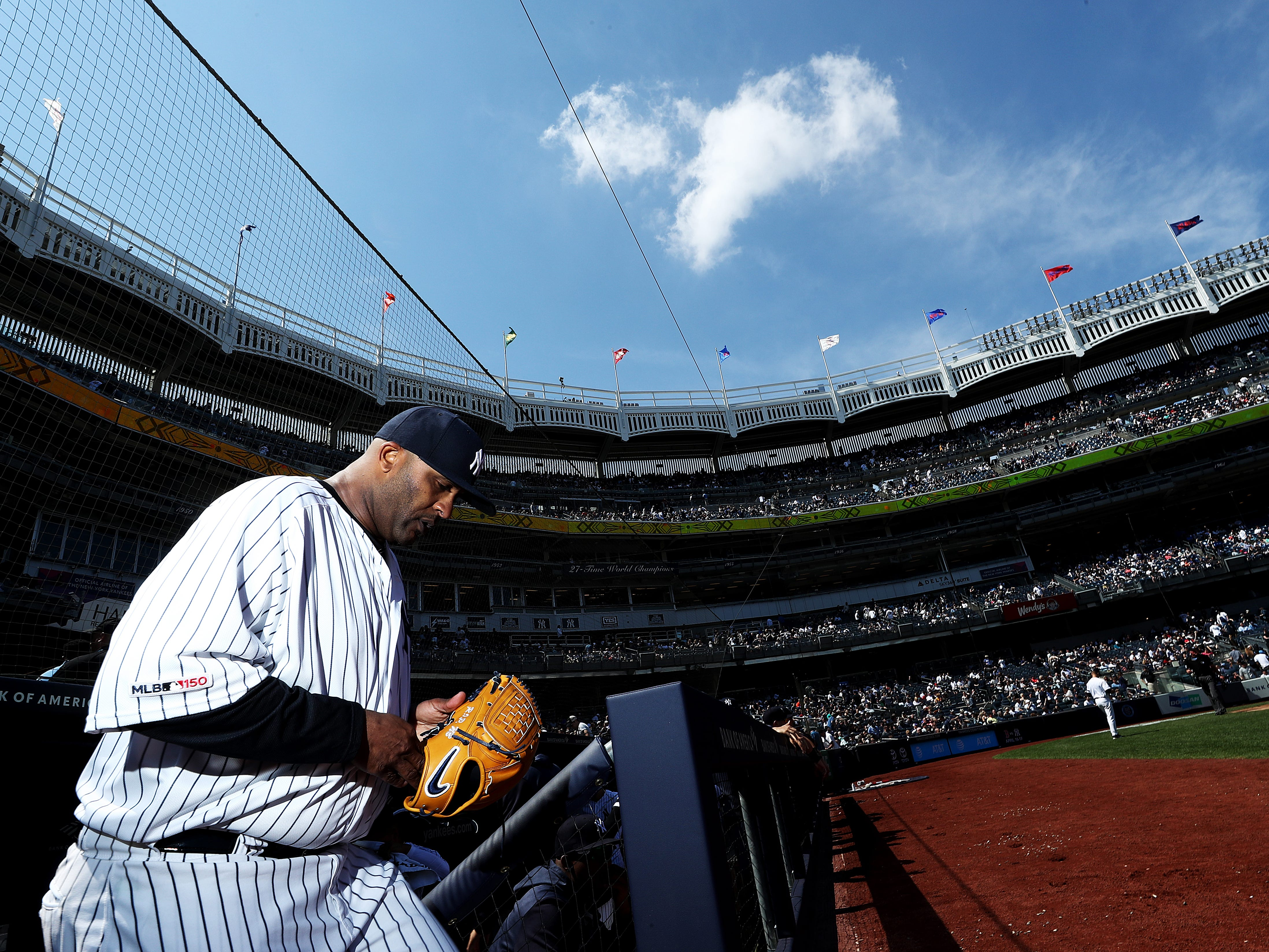 CC Sabathia #52 of the New York Yankees heads onto the field making his first start of his last season in Major League Basebal against the Chicago White Sox during their game at Yankee Stadium on April 13, 2019 in New York City.