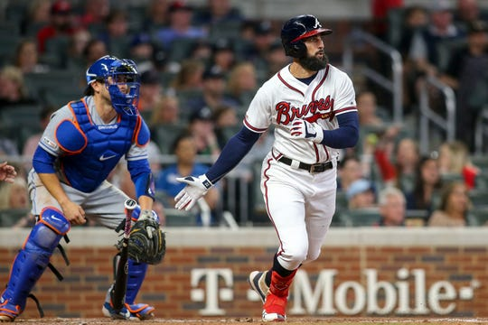 Apr 13, 2019; Atlanta, GA, USA; Atlanta Braves right fielder Nick Markakis (22) hits a RBI double against the New York Mets in the second inning at SunTrust Park.