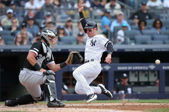Apr 14, 2019; Bronx, NY, USA; New York Yankees left fielder Mike Tauchman (39) scores a run against Chicago White Sox catcher James McCann (33) on a single by New York Yankees right fielder Aaron Judge (not pictured) during the third inning at Yankee Stadium.