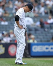 Apr 14, 2019; Bronx, NY, USA; New York Yankees starting pitcher Masahiro Tanaka (19) reacts after allowing a grand slam to Chicago White Sox shortstop Tim Anderson (not pictured) during the fourth inning at Yankee Stadium.