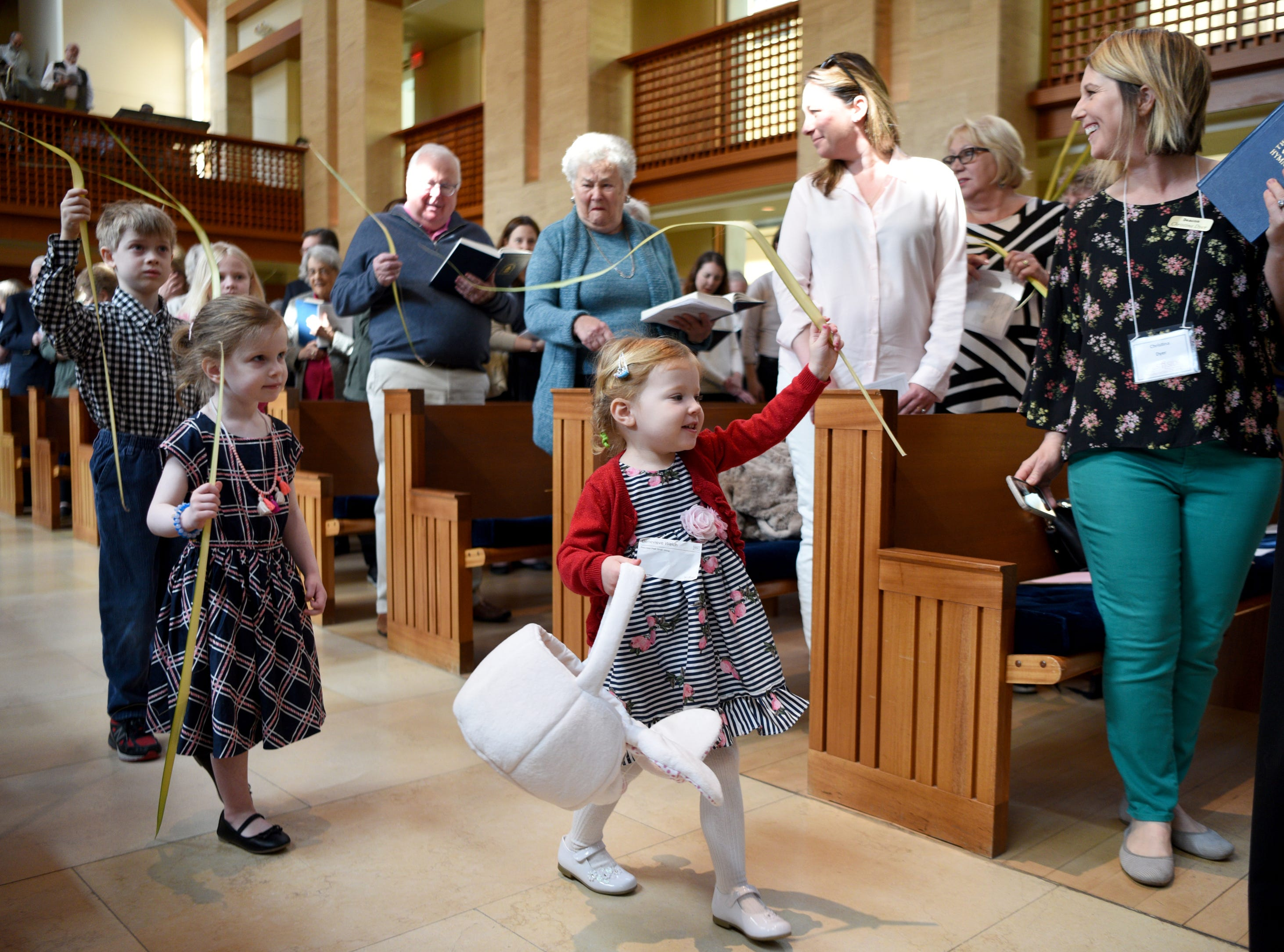 West Side Presbyterian Church in Ridgewood commemorated Palm Sunday on April 14, 2019 during services. Children of the congregation proceed into services waving palms.