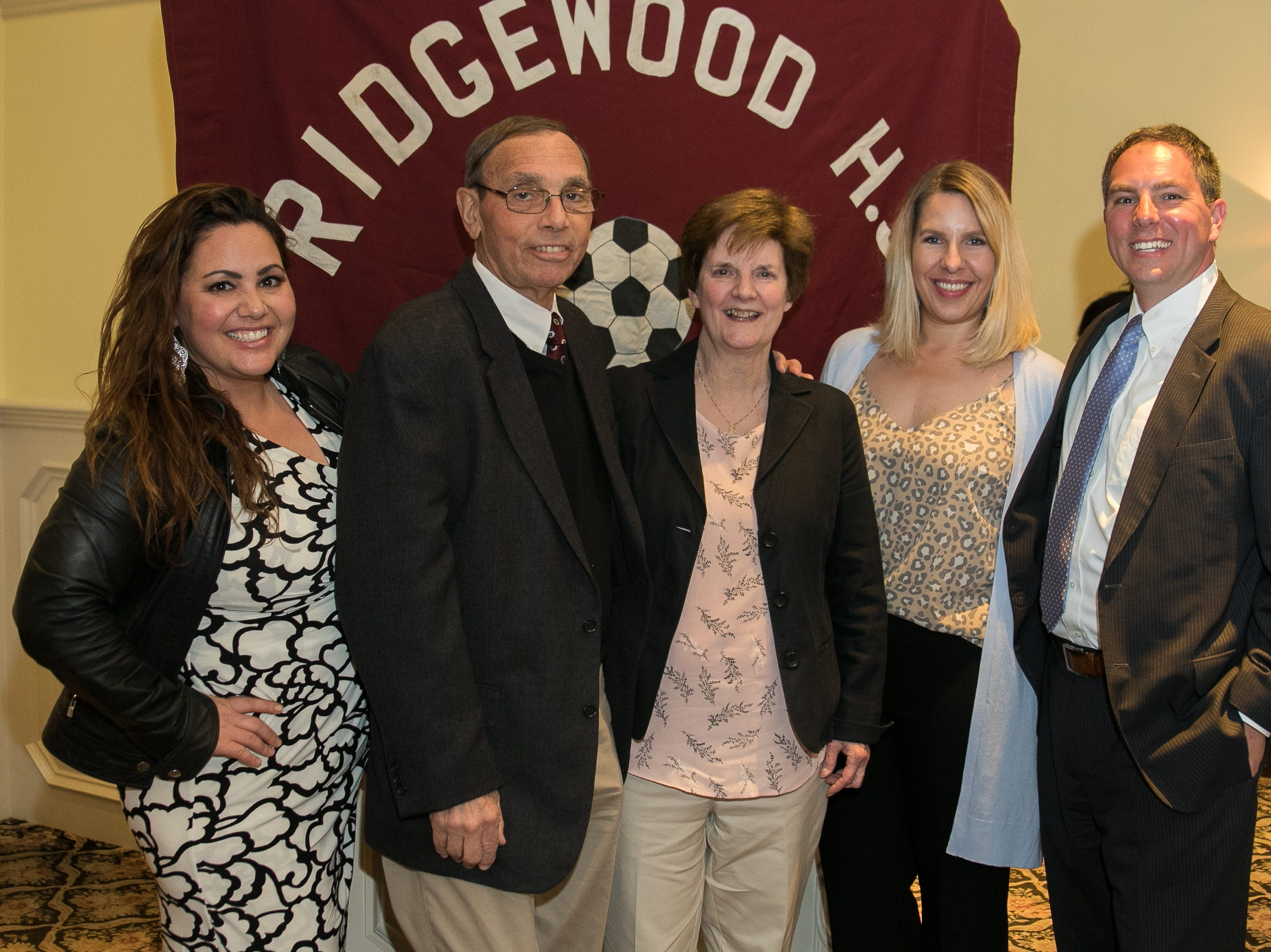 Honored inductee Coach Jeff Yearing with his family. Ridgewood High School held it's Hall of Fame Class of 2018 Induction Dinner, honoring long time coach Jeff Yearing at the Brickhouse in Wyckoff. 04/05/2019