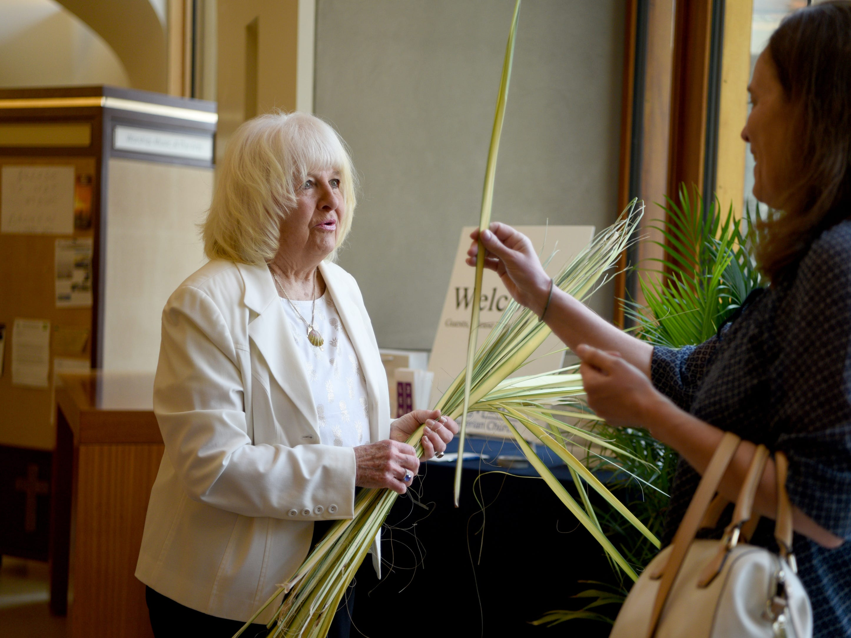 West Side Presbyterian Church in Ridgewood commemorated Palm Sunday on April 14, 2019 during services. Anita Jones hands out palms as people enter church.