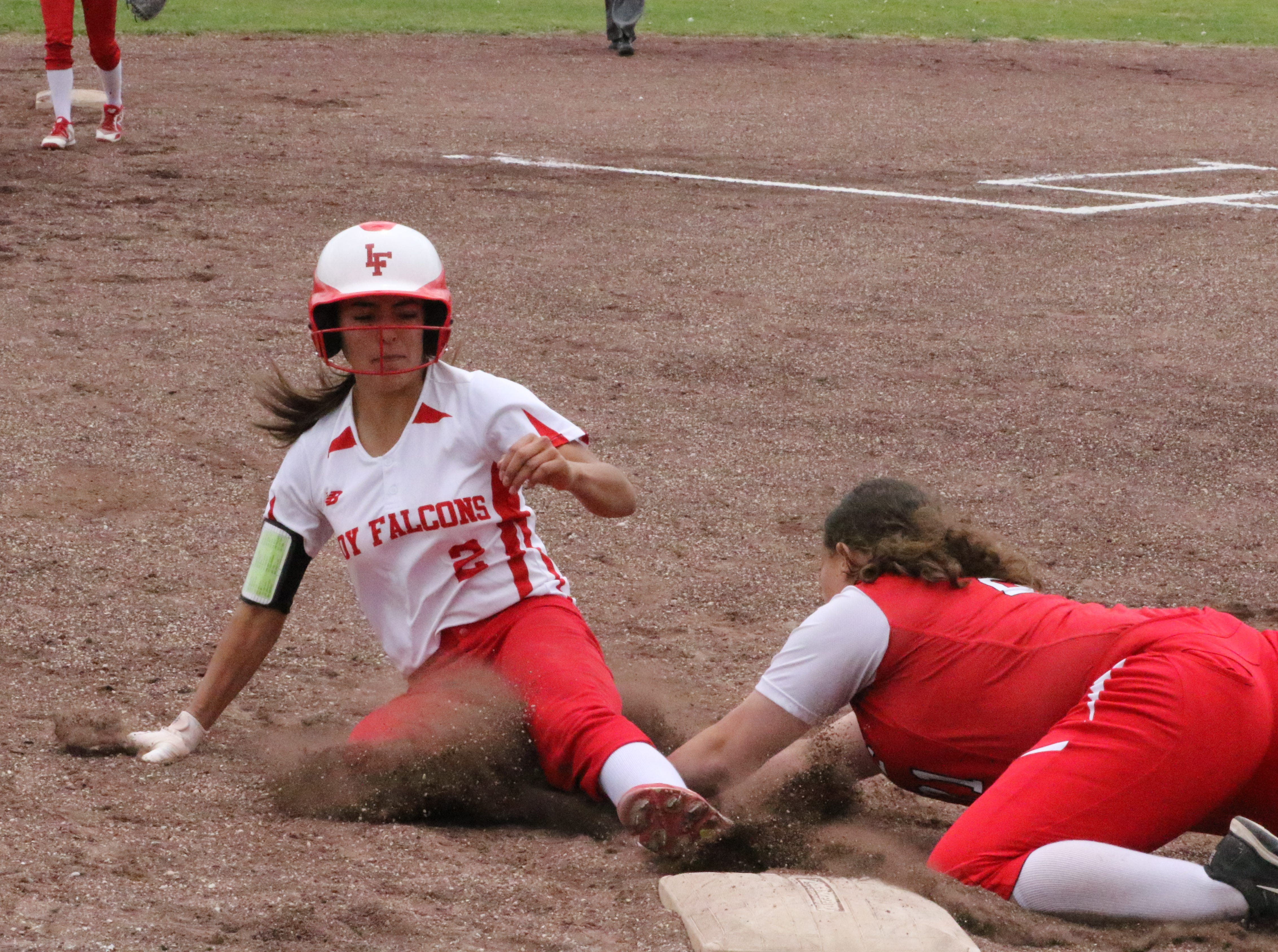 Chasity Onsurez is tagged out while sliding into third base during Game 1 of Saturday's doubleheader. Eunice won Game 1, 13-12 and Loving won Game 2, 16-6.