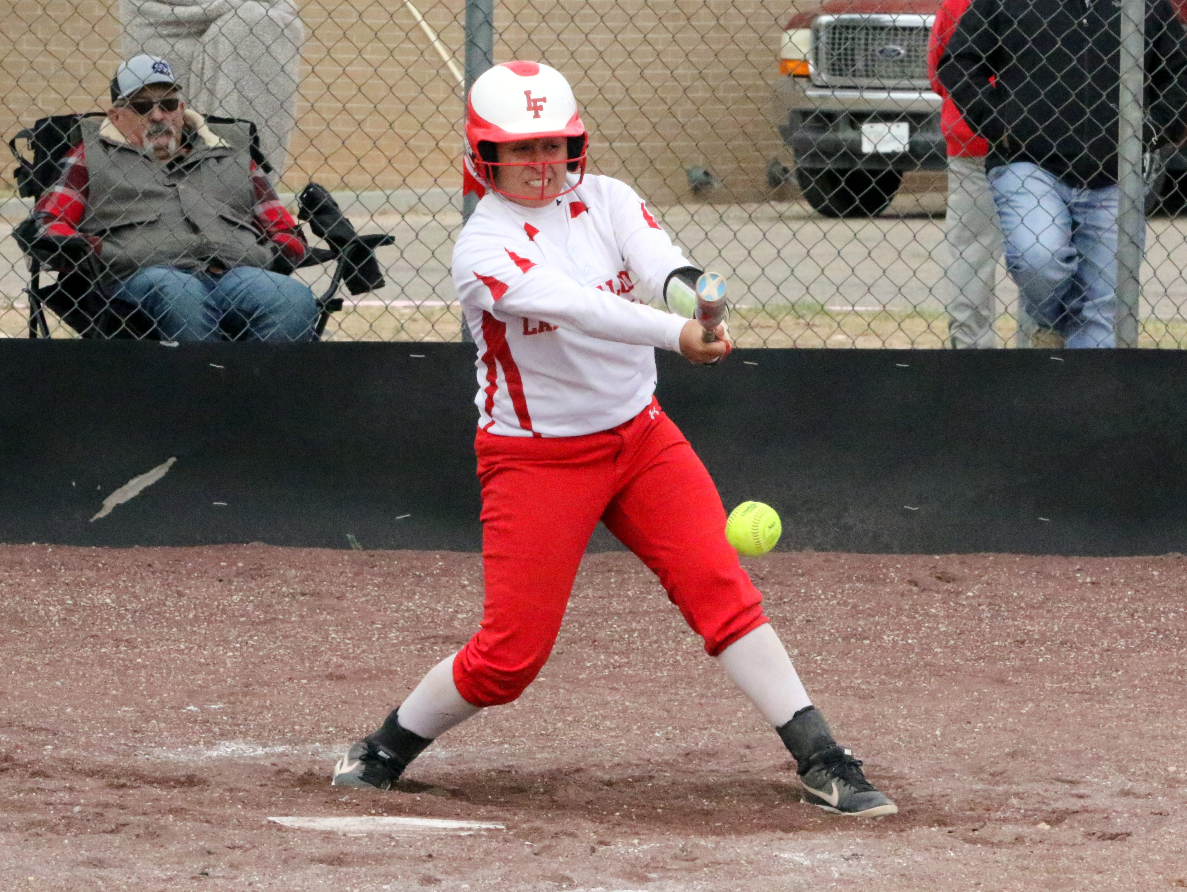 Loving's Angelica Villegas connects with a pitch during Game 2 of Saturday's doubleheader. Eunice won Game 1, 13-12 and Loving won Game 2, 16-6.