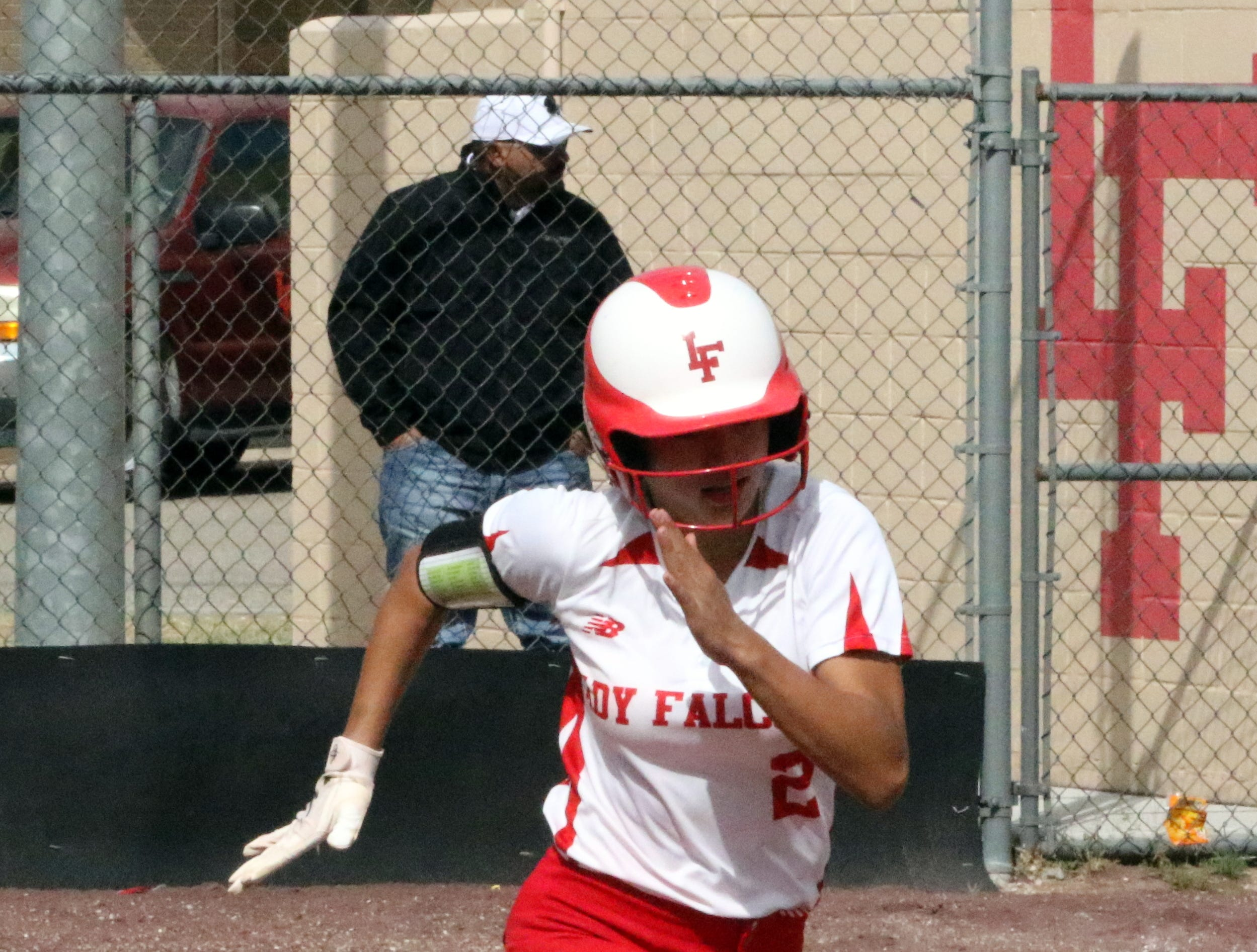 Chastity Onsurez sprints to first base during Game 2 of Saturday's doubleheader. Eunice won Game 1, 13-12 and Loving won Game 2, 16-6.
