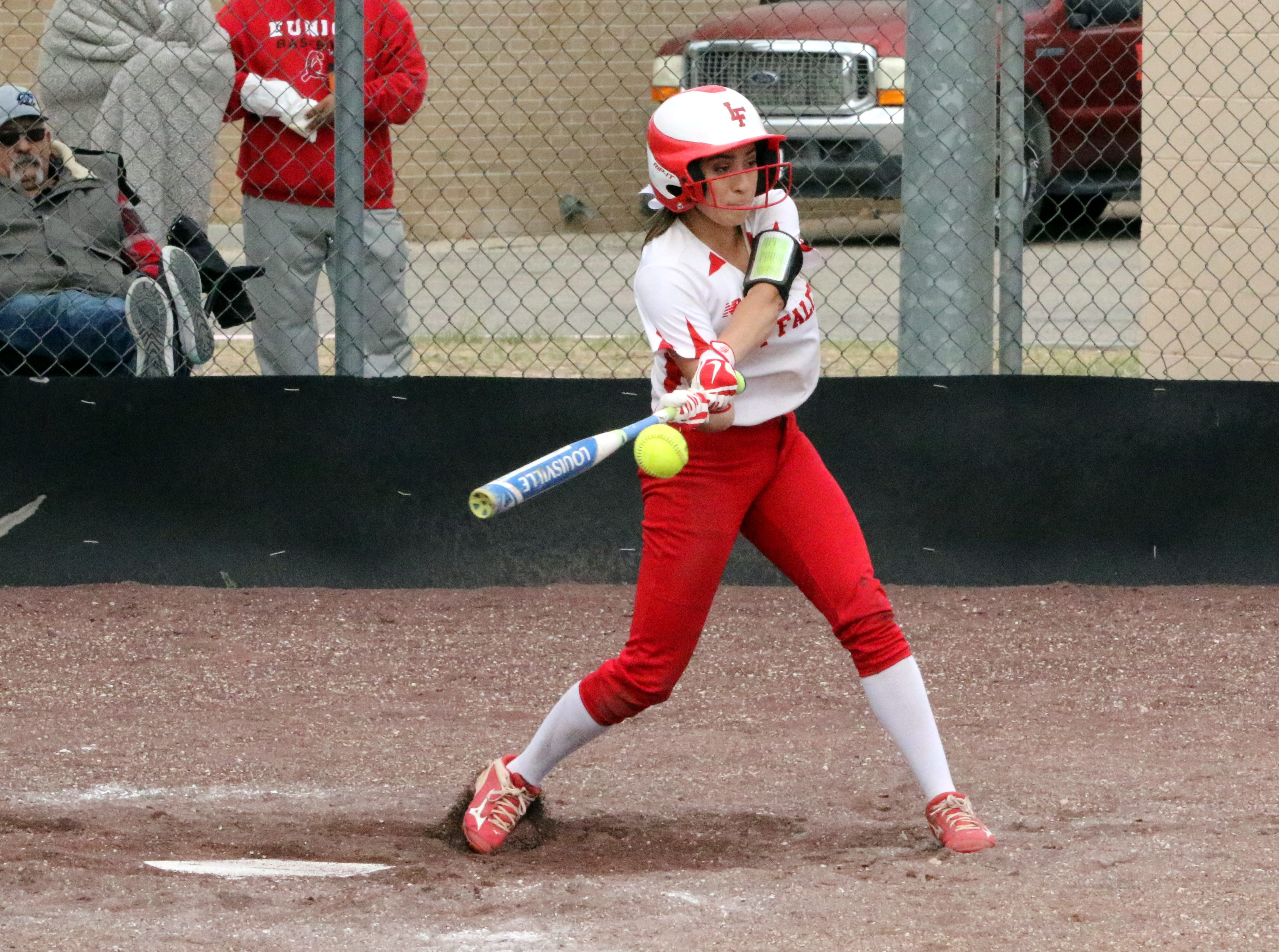 Anyssa Rodriguez connects with a pitch during Game 2 of Saturday's doubleheader. Eunice won Game 1, 13-12 and Loving won Game 2, 16-6.