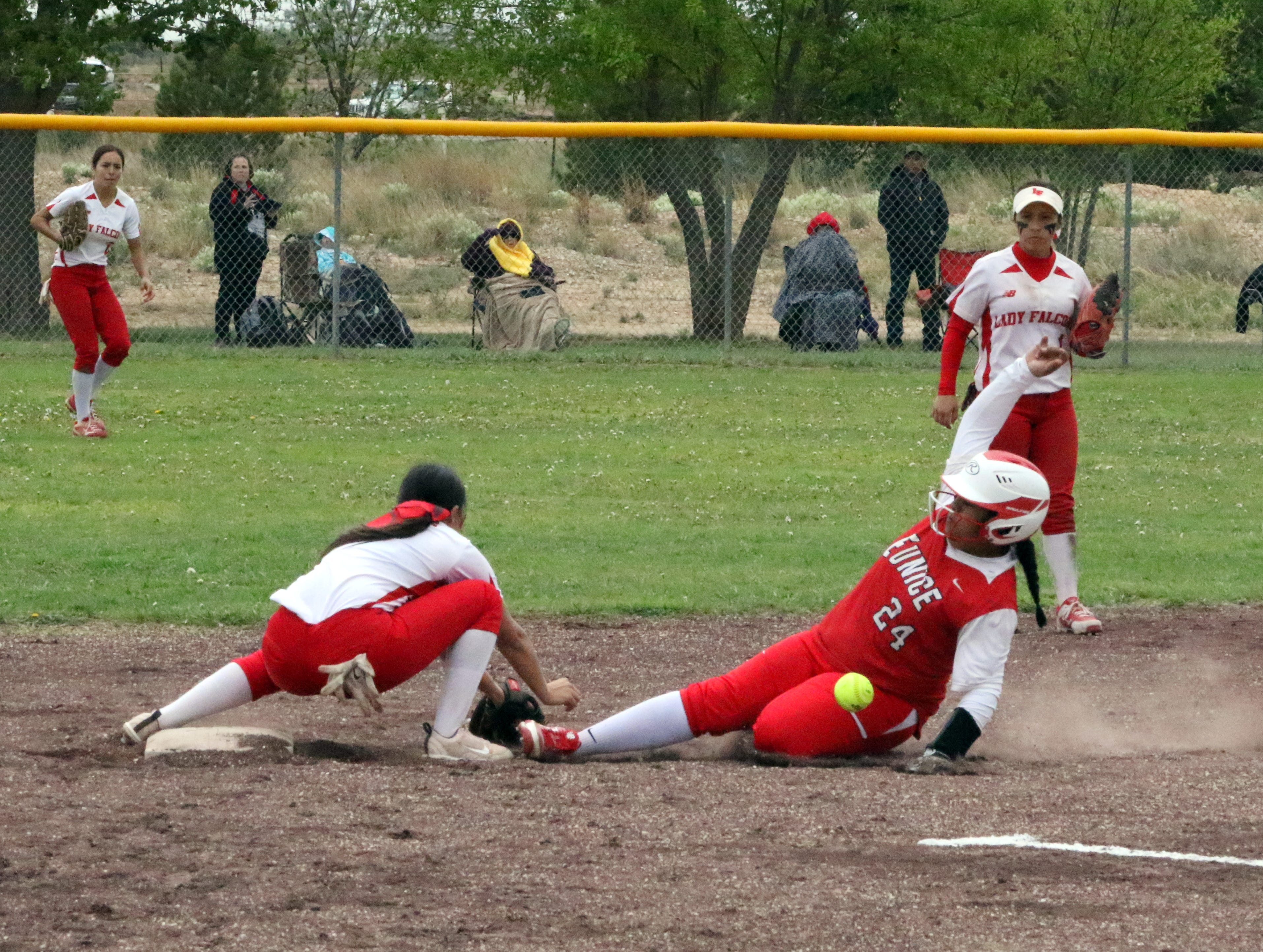 Eunice's Cheyanne Nichols safely slides into second base during Game 1 of Saturday's doubleheader. Eunice won Game 1, 13-12 and Loving won Game 2, 16-6.