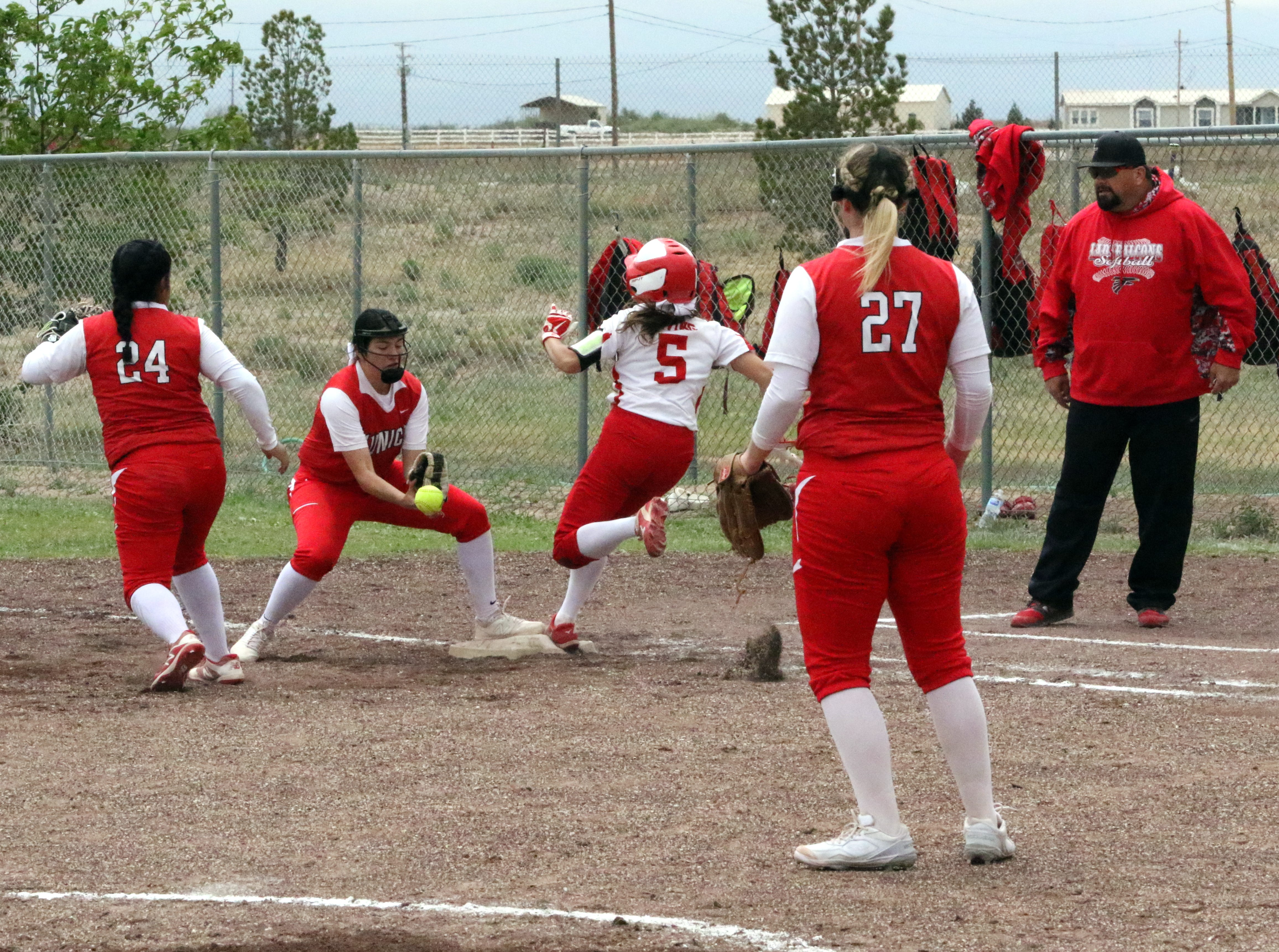 Anyssa Rodriguez (5) beats out a throw to first base during Game 1 of Saturday's doubleheader. Eunice won Game 1, 13-12 and Loving won Game 2, 16-6.