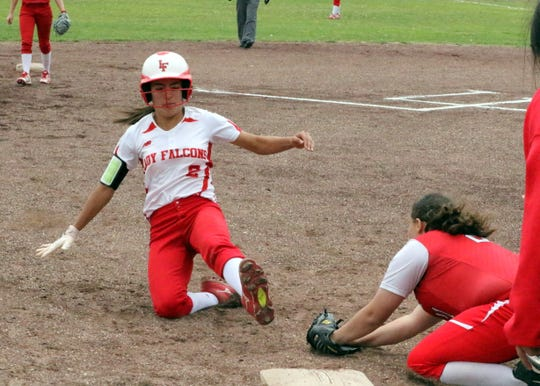 Chasity Onsurez slides into third base during Game 1 of Saturday's doubleheader. Eunice won Game 1, 13-12 and Loving won Game 2, 16-6.