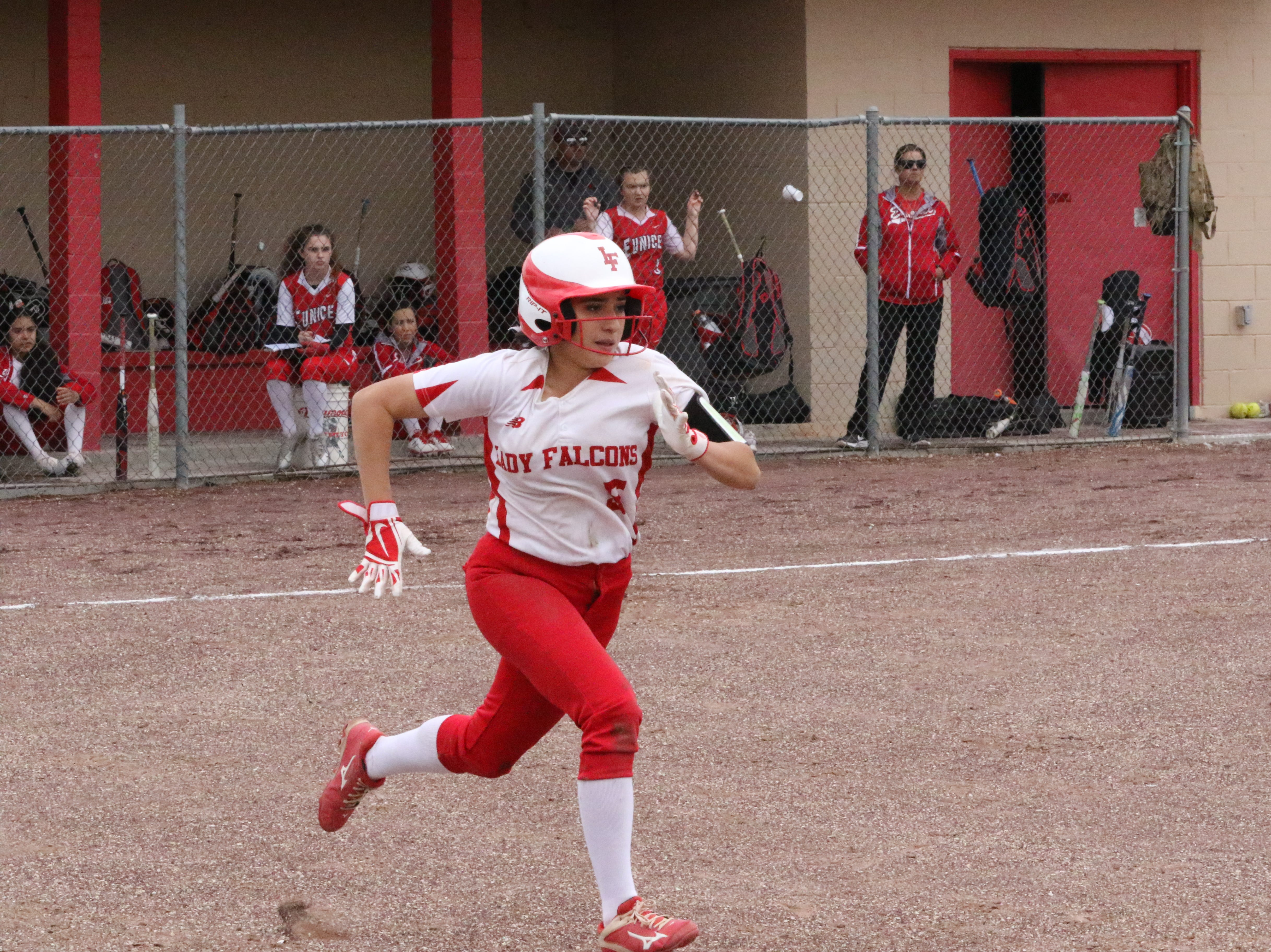 Anyssay Rodriguez runs to first base during the first game of Saturday's doubleheader. Eunice won Game 1, 13-12 and Loving won Game 2, 16-6.