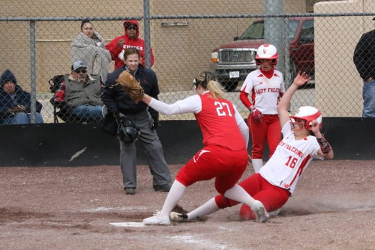 Loving's Faith McDonald safely slides into home to score during Game 2 of Saturday's doubleheader against Eunice. Loving won Game 2, 16-6 in five innings.