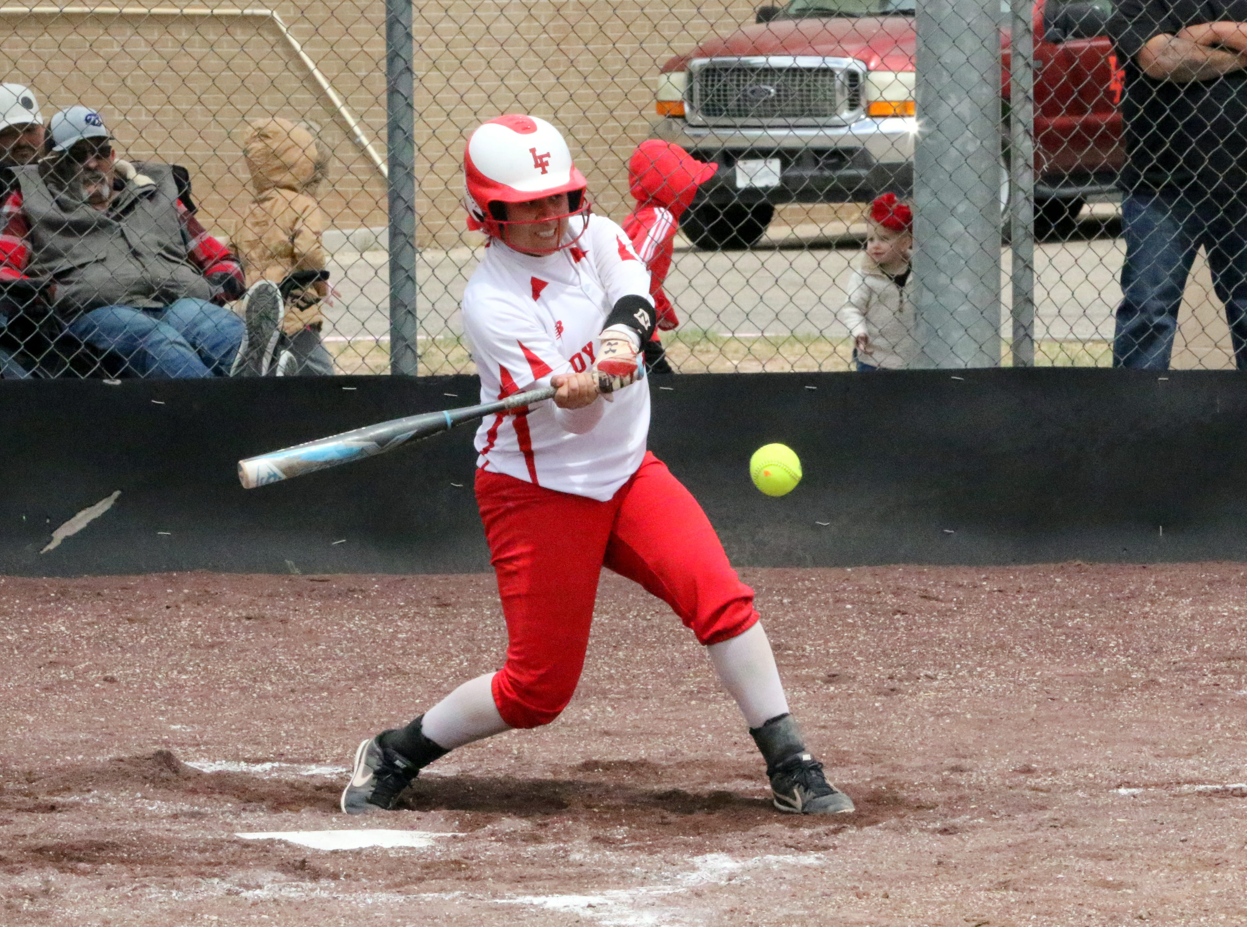 Angellica Villegas connects with a pitch during Game 1 of Saturday's doubleheader.