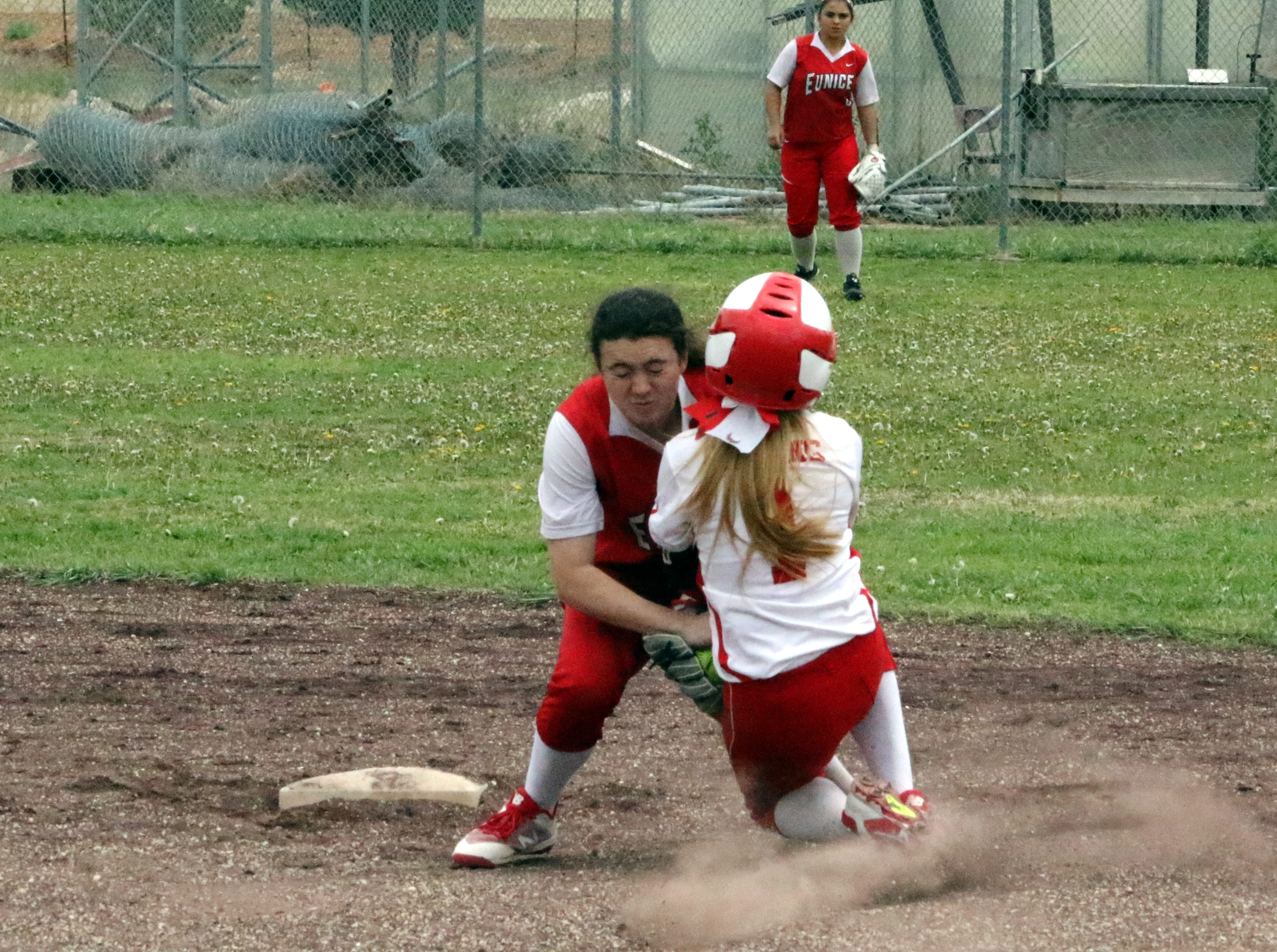 Tiana Rodriguez is tagged out by Eunice after she attempted to steal second base during Saturday's doubleheader.