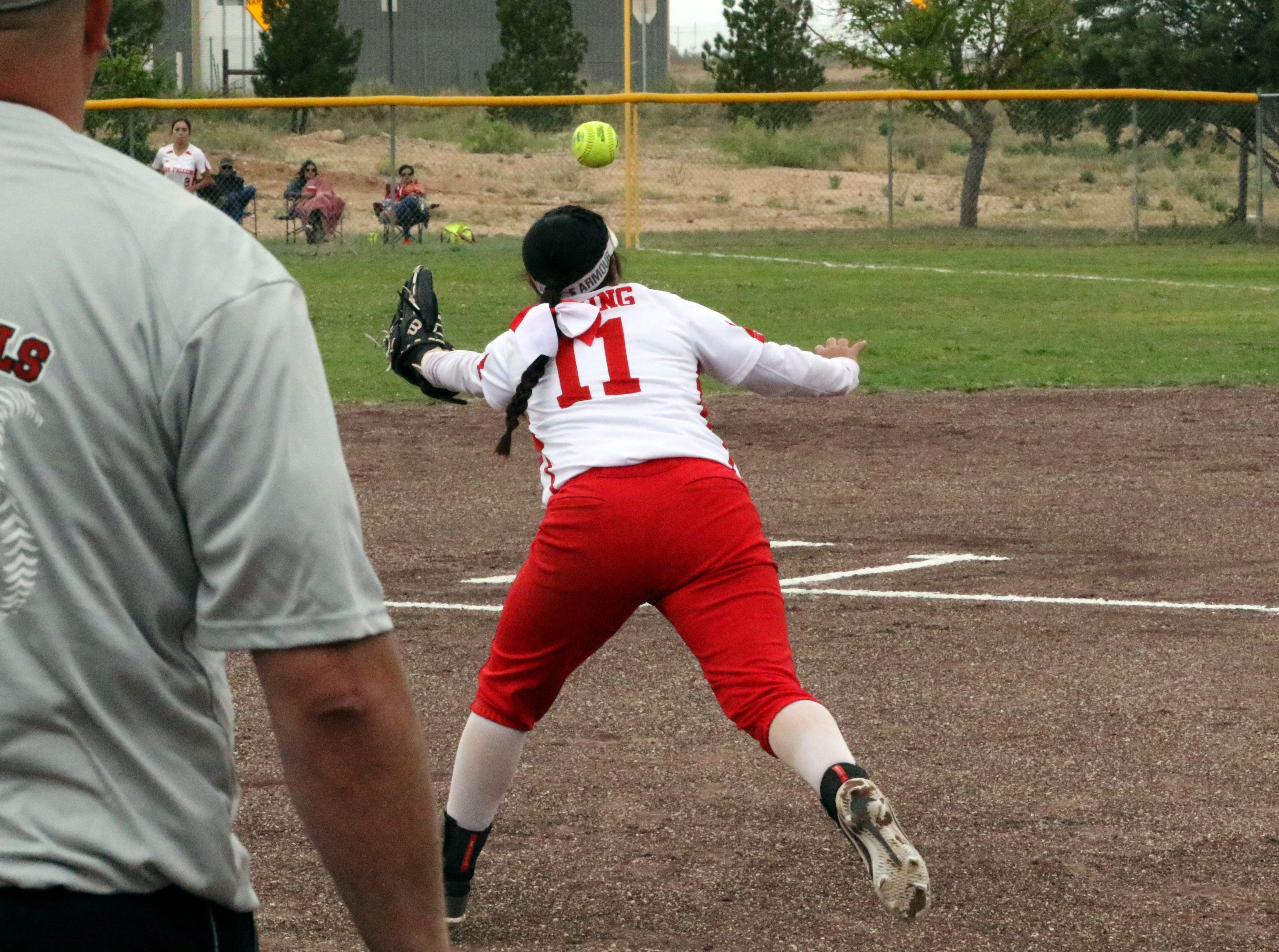 Loving's Angelica Villegas dives for a line drive during Game 1 of Saturday's doubleheader against Eunice.