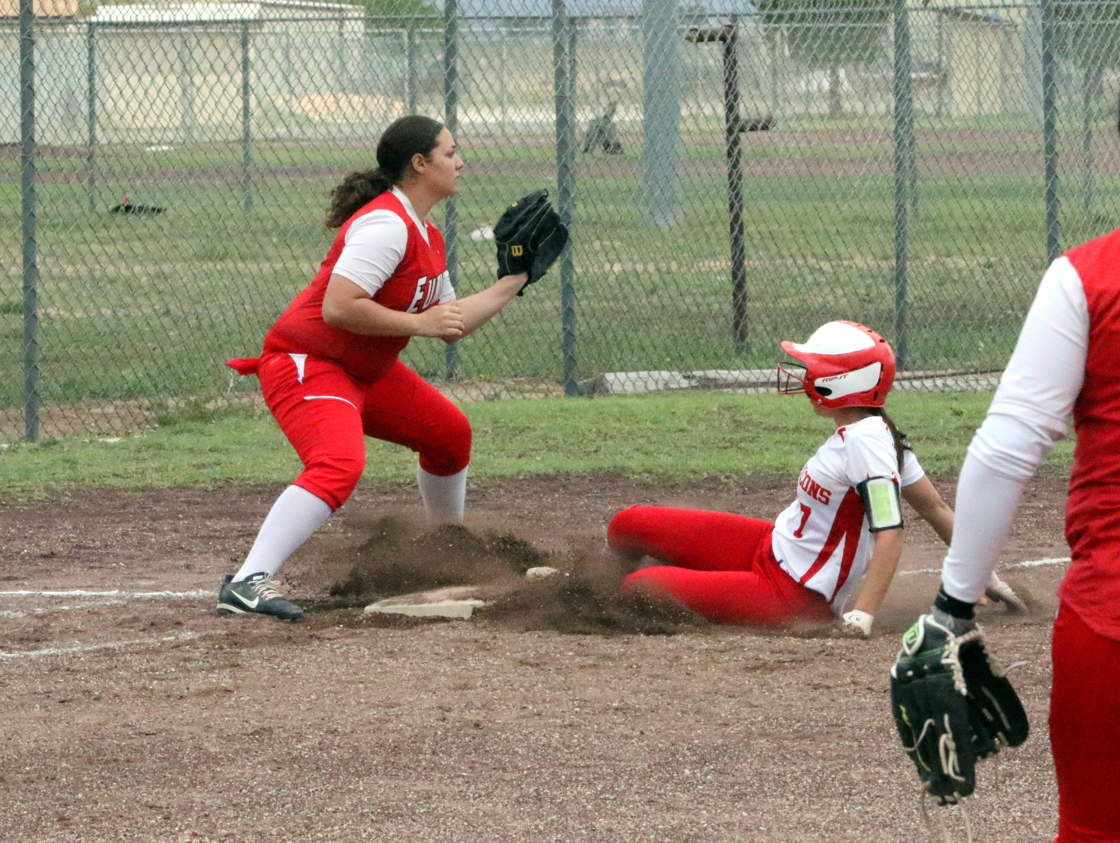 Frankie Hernandez safely slides into third base during Saturday's doubleheader. Eunice won Game 1, 13-12 and Loving won Game 2, 16-6.