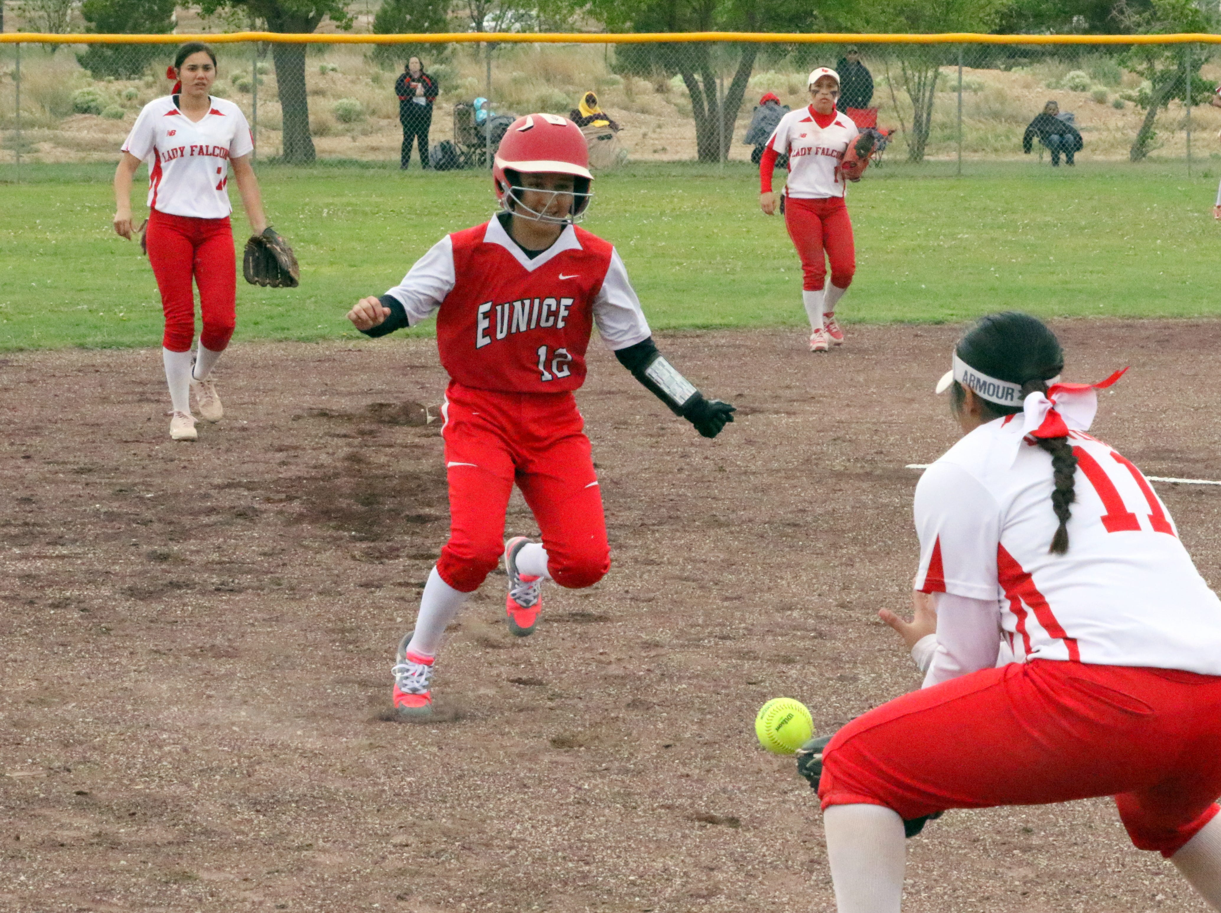 Eunice's Kendra Cabalero is caught in a rundown during Game 1 of Saturday's doubleheader. Eunice won Game 1, 13-12 and Loving won Game 2, 16-6.