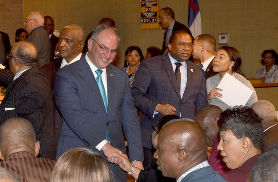 Louisiana Gov. John Bel Edwards shakes hands with members of congregations Sunday, April 14, 2019, during a unity service on Palm Sunday from three historically black St. Landry Parish churches lost to arson over 10 days.