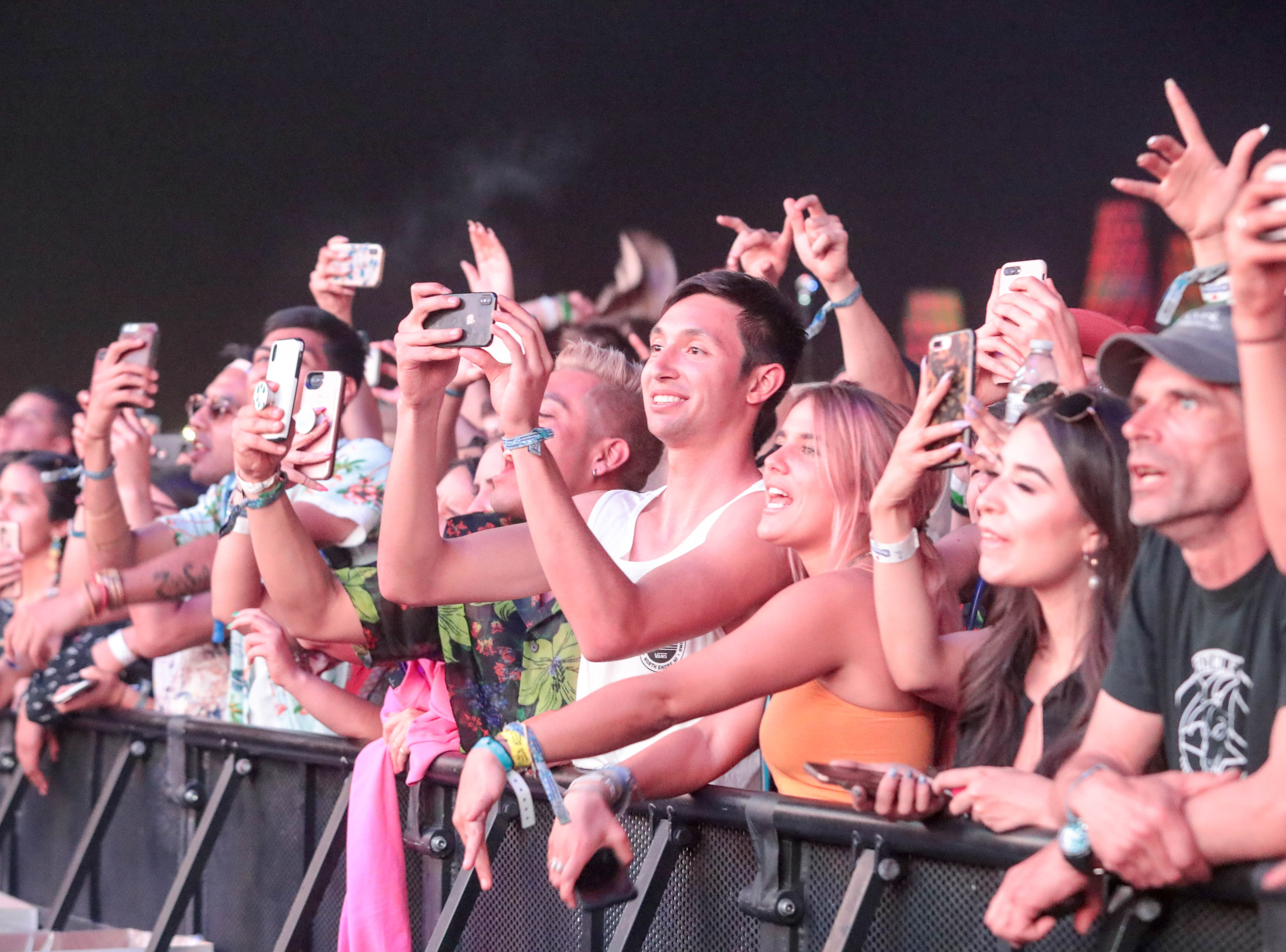 Fans listen as Weezer performs on Saturday, April 13, 2019 at Coachella Valley Music and Arts Festival in Indio, Calif.