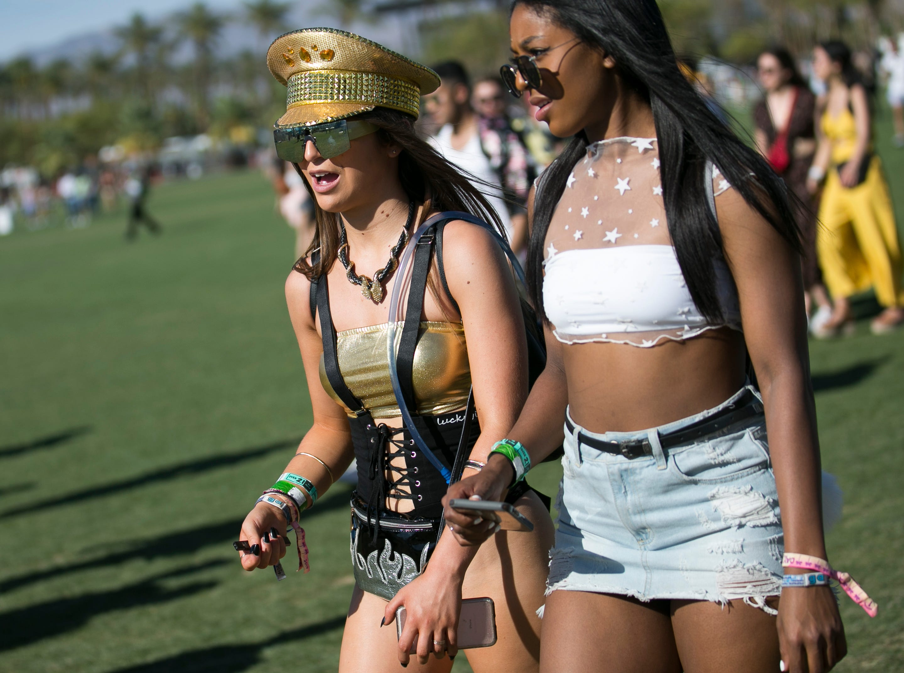 Jenna Udell (left) and Starla Upshaw (right) walk through the festival grounds at Coachella 2019 in Indio, Calif. on Sat. April 13, 2019.