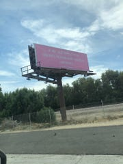 A billboard for Ariana Grande from Republic Records sign stands near Jefferson Street exit on Interstate 10, April 14, 2019.