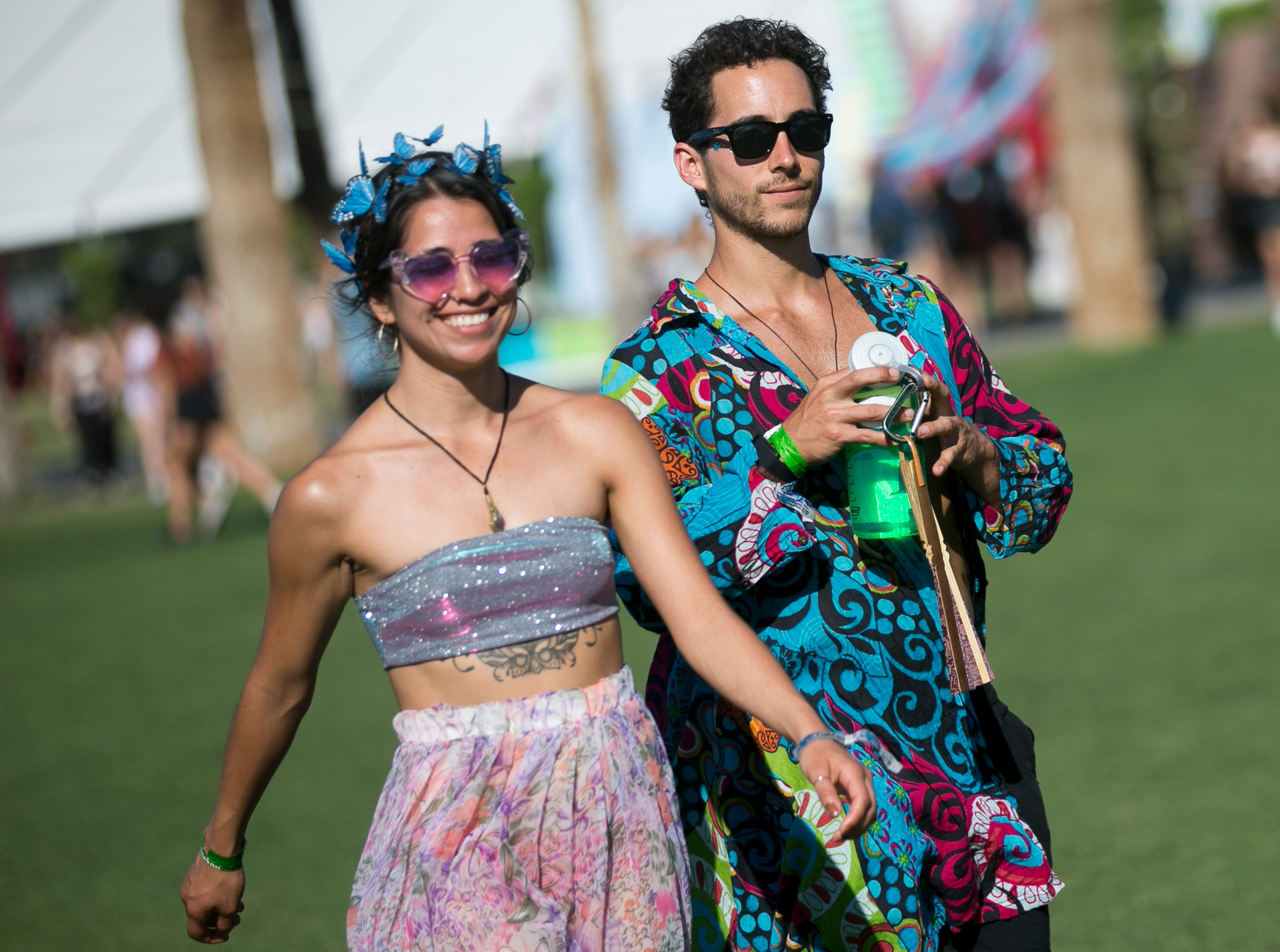 Rose Beltran (left) and Corey Pearls (right) walk through the festival grounds at Coachella 2019 in Indio, Calif. on Sat. April 13, 2019.