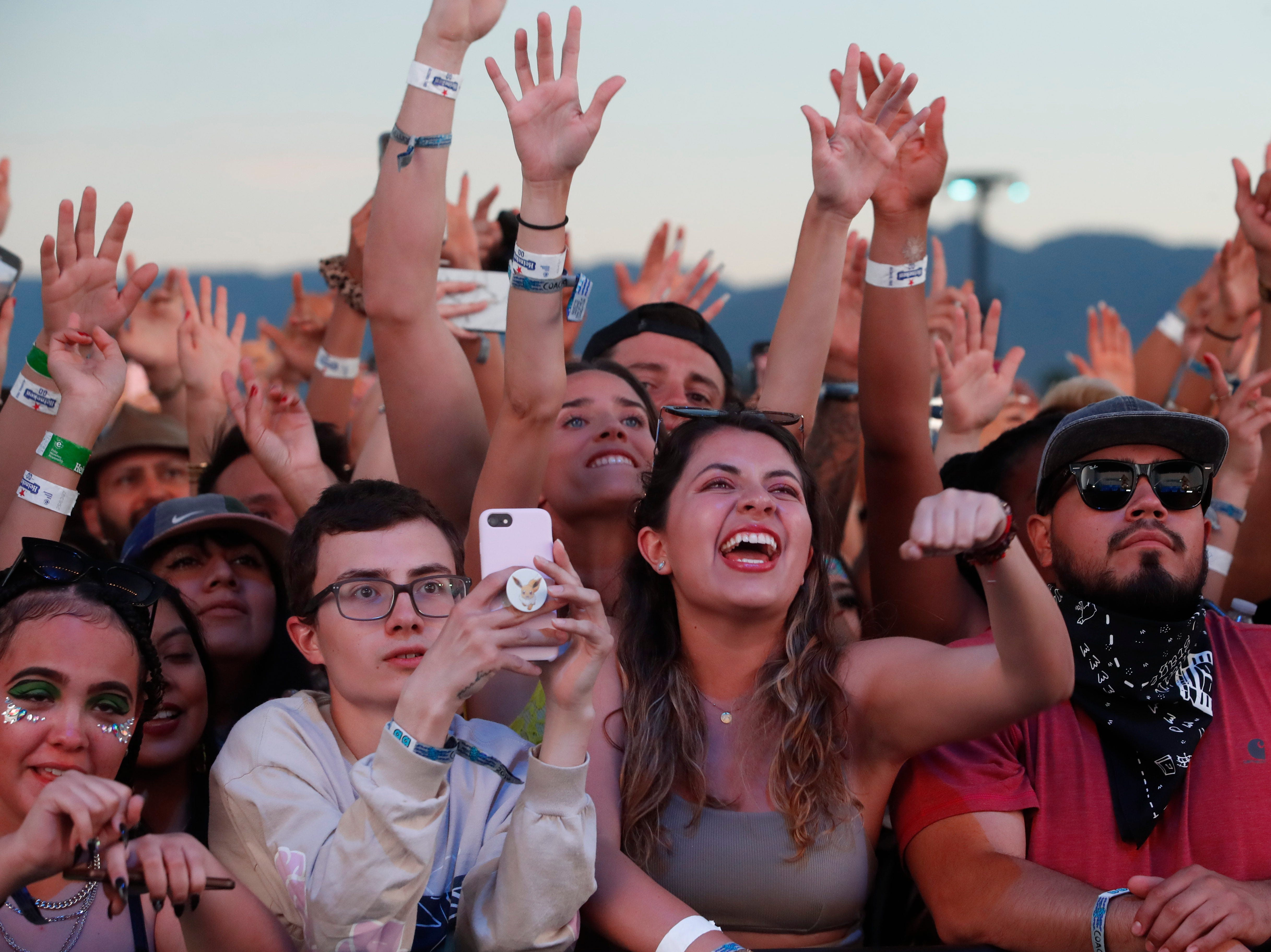 Fans of J Balvin cheer his performance on the Coachella Stage during the 2019 Coachella Valley Music and Arts Festival held at the Empire Polo Club in Indio, California on April 13, 2019.