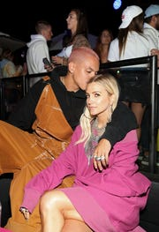 Evan Ross (L) and Ashlee Simpson attend the Levi's Brand Presents Neon Carnival with Bondi Sands and POKÉMON: Detective Pikachu on April 13, 2019 in Thermal, Calif.