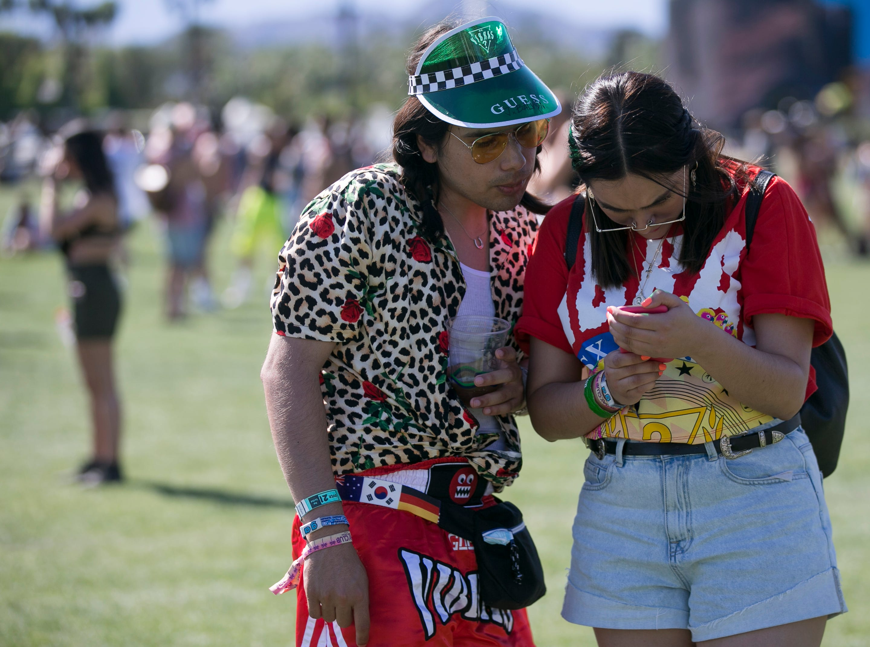 Festival goers walk the grounds at Coachella 2019 in Indio, Calif. on Sat. April 13, 2019.
