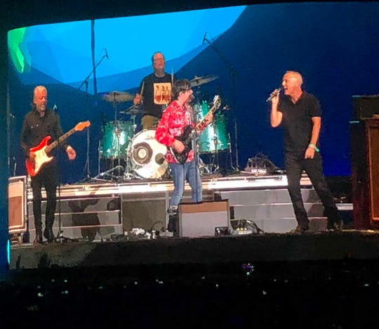 """Tears for Fears joins Weezer on stage for """"Everybody Wants to Rule the World"""" during their Saturday night set at the Coachella Valley Music and Arts Festival in Indio, Calif., April 13, 2019."""