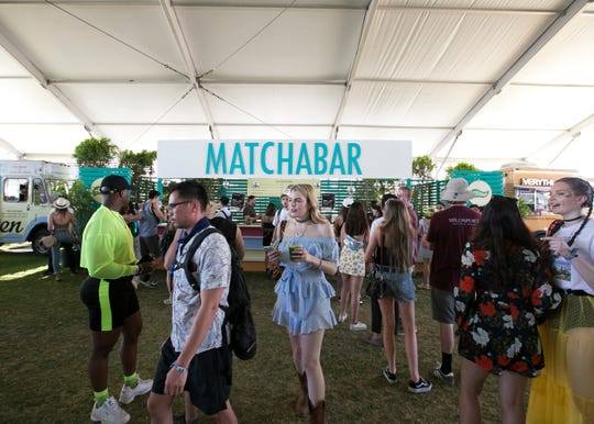 Festivalgoers eat food inside the Indio Central Market at the Coachella Valley Music and Arts Festival in Indio, Calif., on Saturday, April 13, 2019.