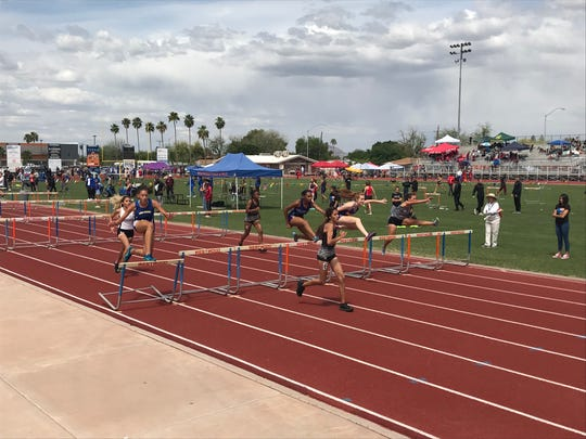 April 12, 2019; girls compete in the 100-meter hurdle event at Hohokam Invitational at Mesa Westwood.