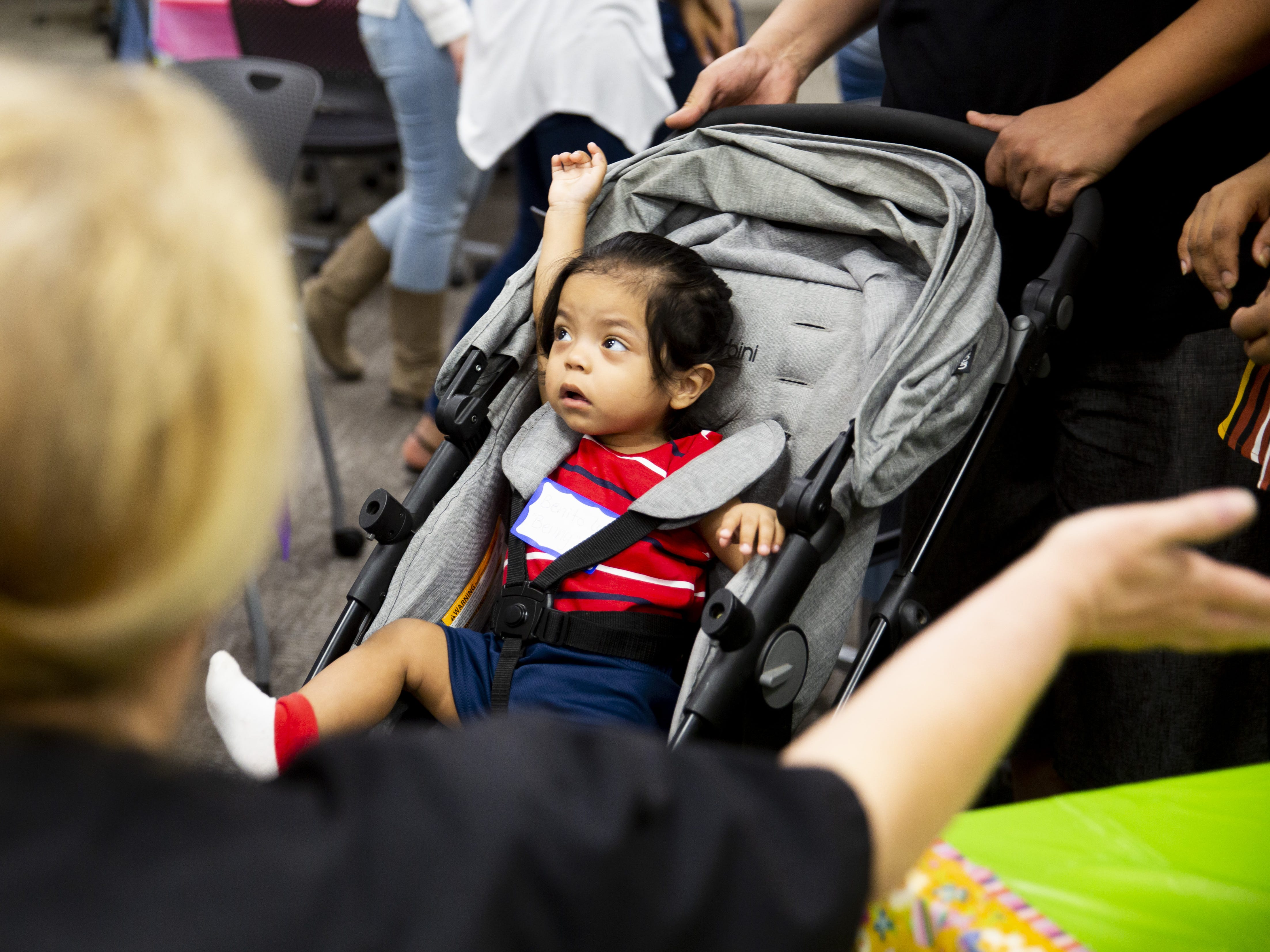 Benito Lupe Lopez, who was born three months early, stretches in his stroller at the Preemie NICU Reunion at Banner University Medical Center on April 13, 2019.