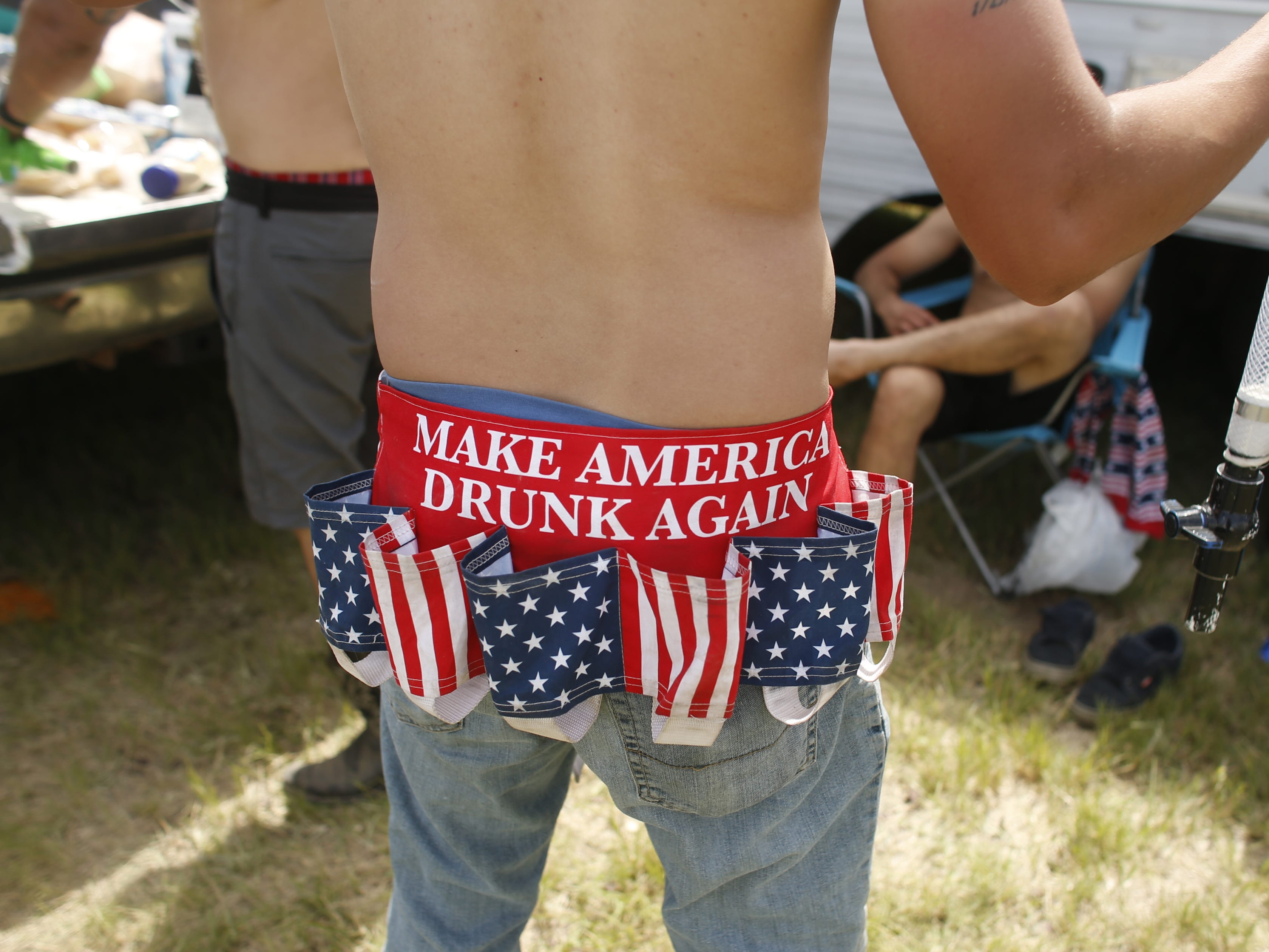 "Max Pena wears a ""Make America Drunk Again"" beer belt holster during Country Thunder in Florence, Ariz. on Sunday, April 14, 2019."