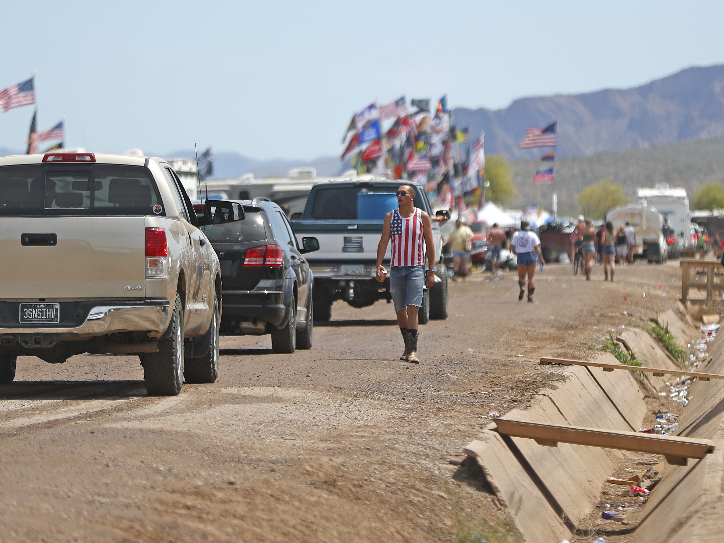 A line backs up as trucks and campers begin to exit in the morning during Country Thunder in Florence, Ariz. on Sunday, April 14, 2019.