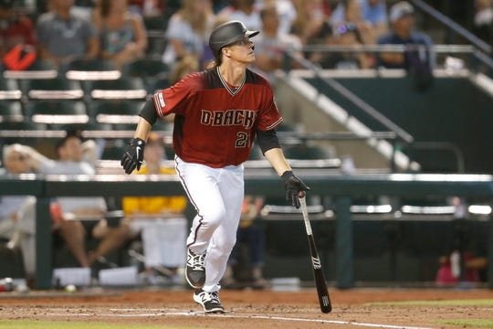 Zack Greinke watches a hit in Sunday's game.