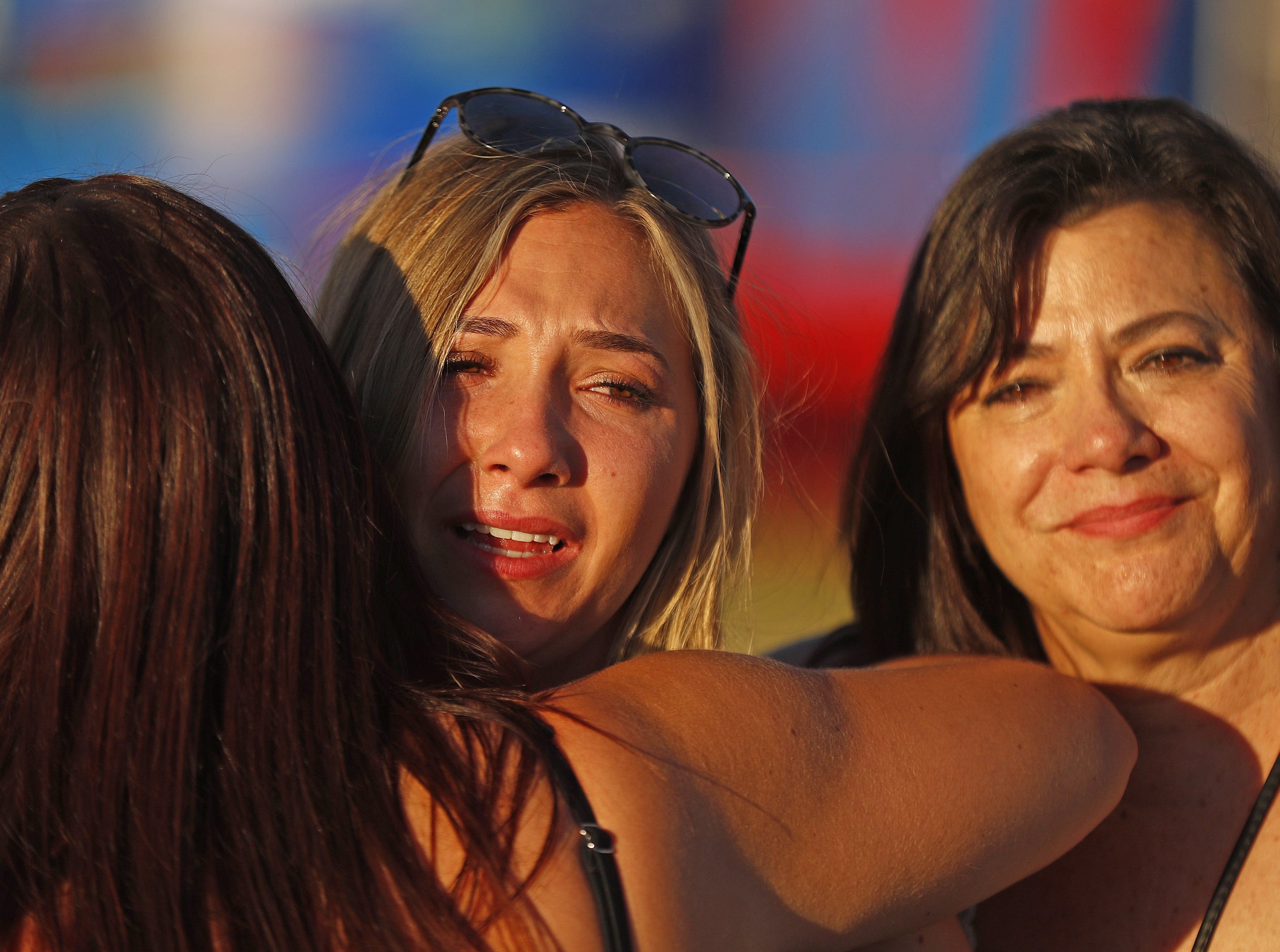 Kalynn Alicata (right) receives a hug from another survivor of the Route 91 Harvest Festival shooting during Country Thunder in Florence, Arizona, on April 13, 2019.