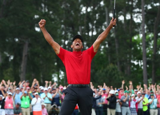 Apr 14, 2019: Tiger Woods celebrates after making a putt on the 18th green to win The Masters golf tournament at Augusta National Golf Club.