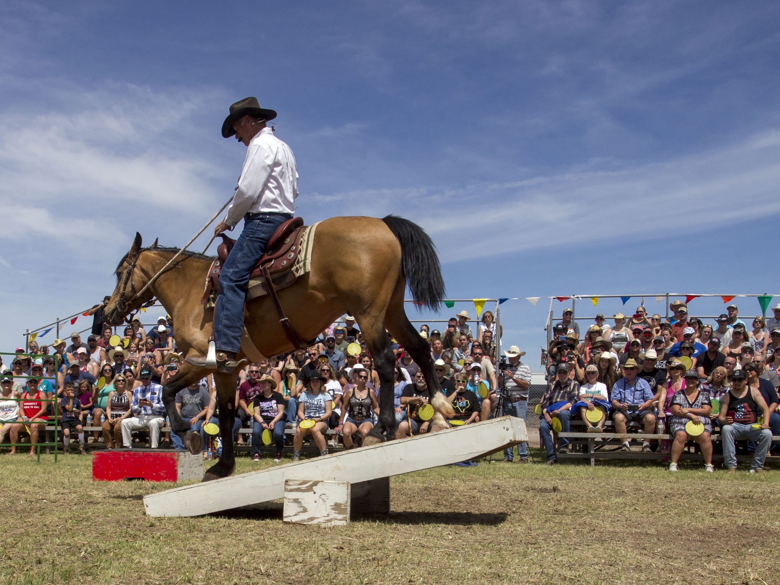 During his sermon, ordained pastor Randy Helm demonstrates with his horse, Starbuck, how to overcome obstacles during Cowboy Church at Country Thunder Arizona on Sunday, April 14, 2019, in Florence, Arizona.