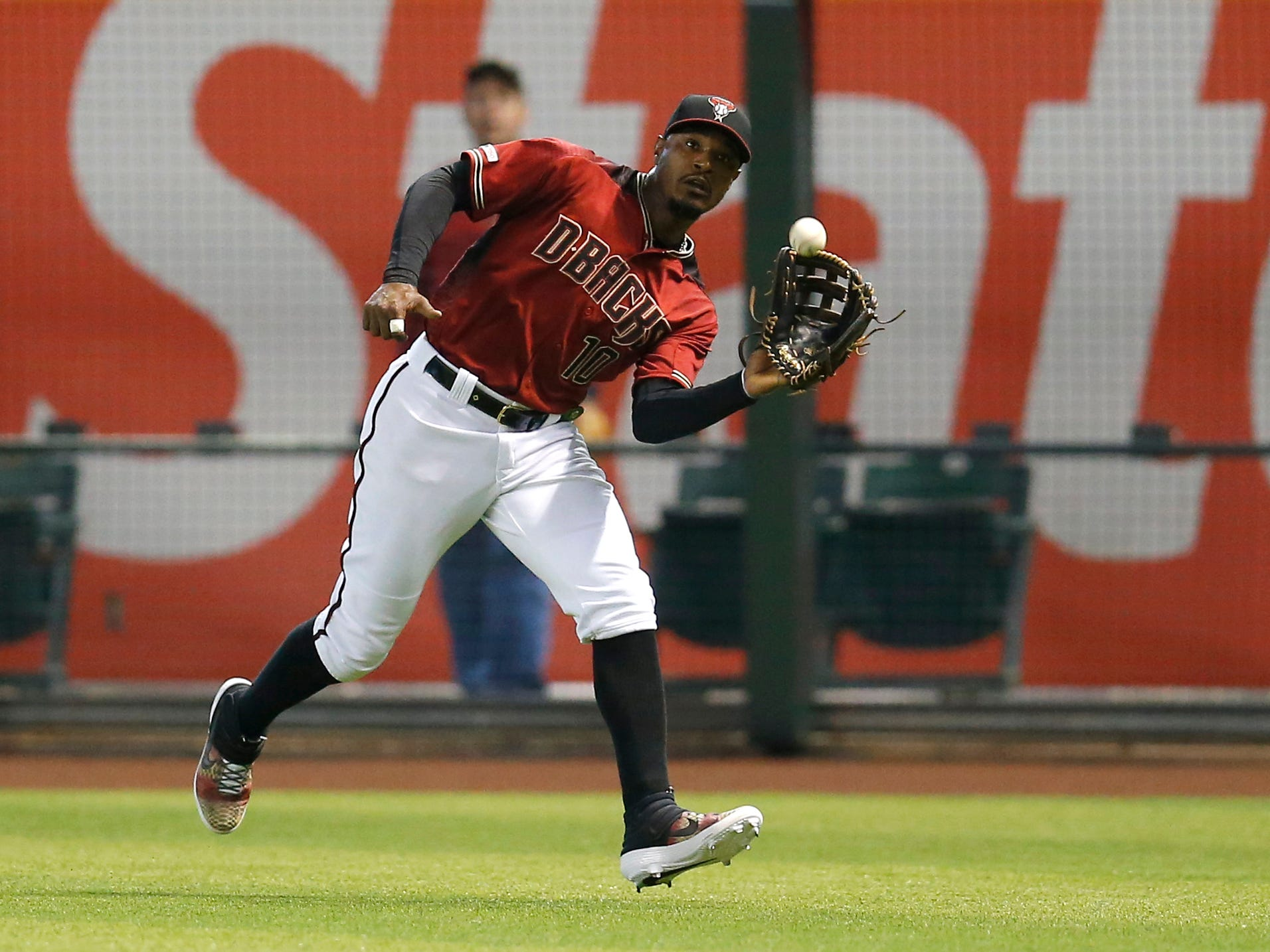 Arizona Diamondbacks right fielder Adam Jones makes a running catch on a ball hit by Hunter Renfroe in the first inning during a baseball game, Sunday, April 14, 2019, in Phoenix. (AP Photo/Rick Scuteri)