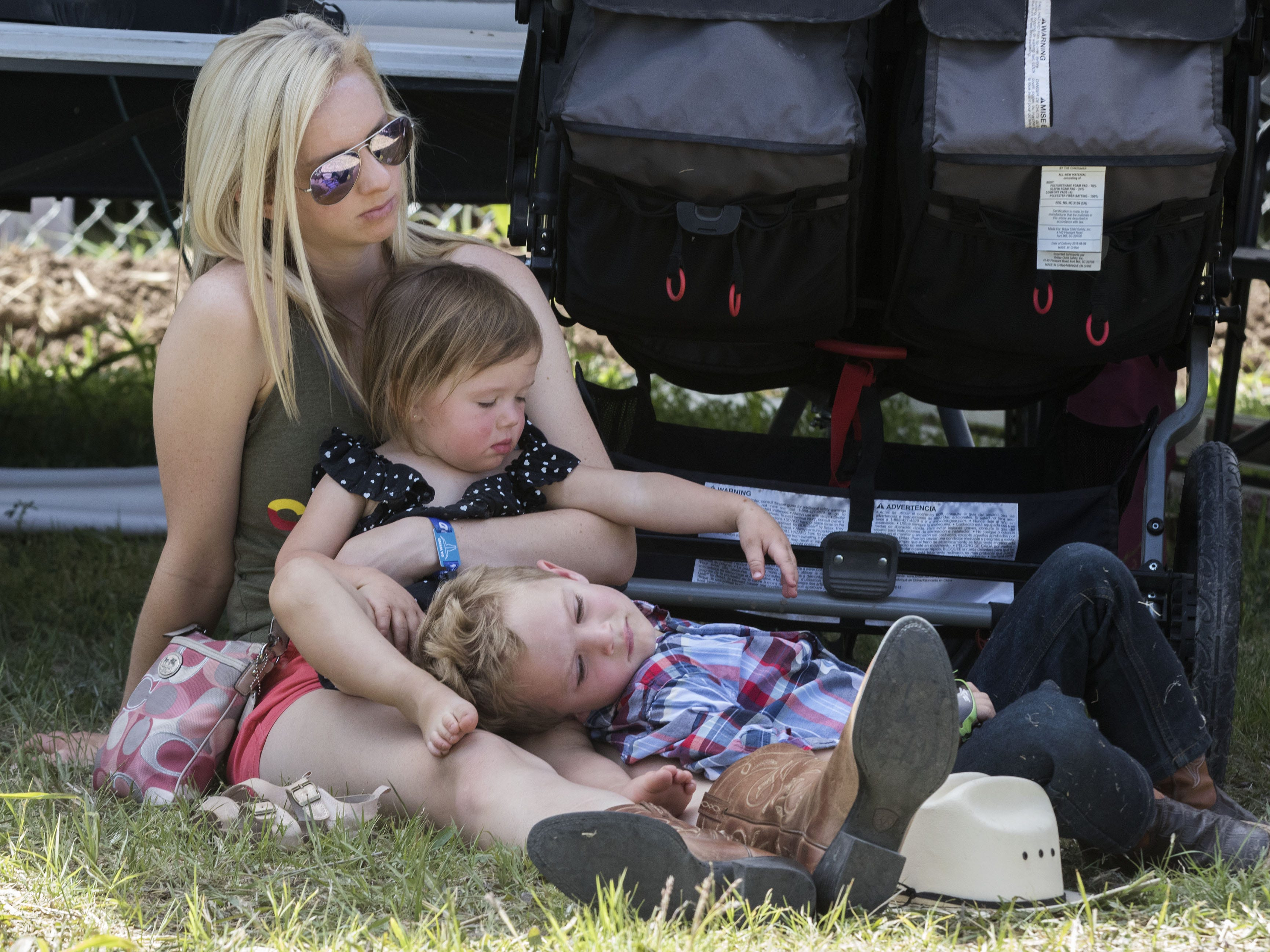 Beverly Pense of Tucson holds her 4-year-old nephew Cole and 2-year-old niece Rylan Schroeder during Cowboy Church at Country Thunder Arizona on Sunday, April 14, 2019, in Florence, Arizona.
