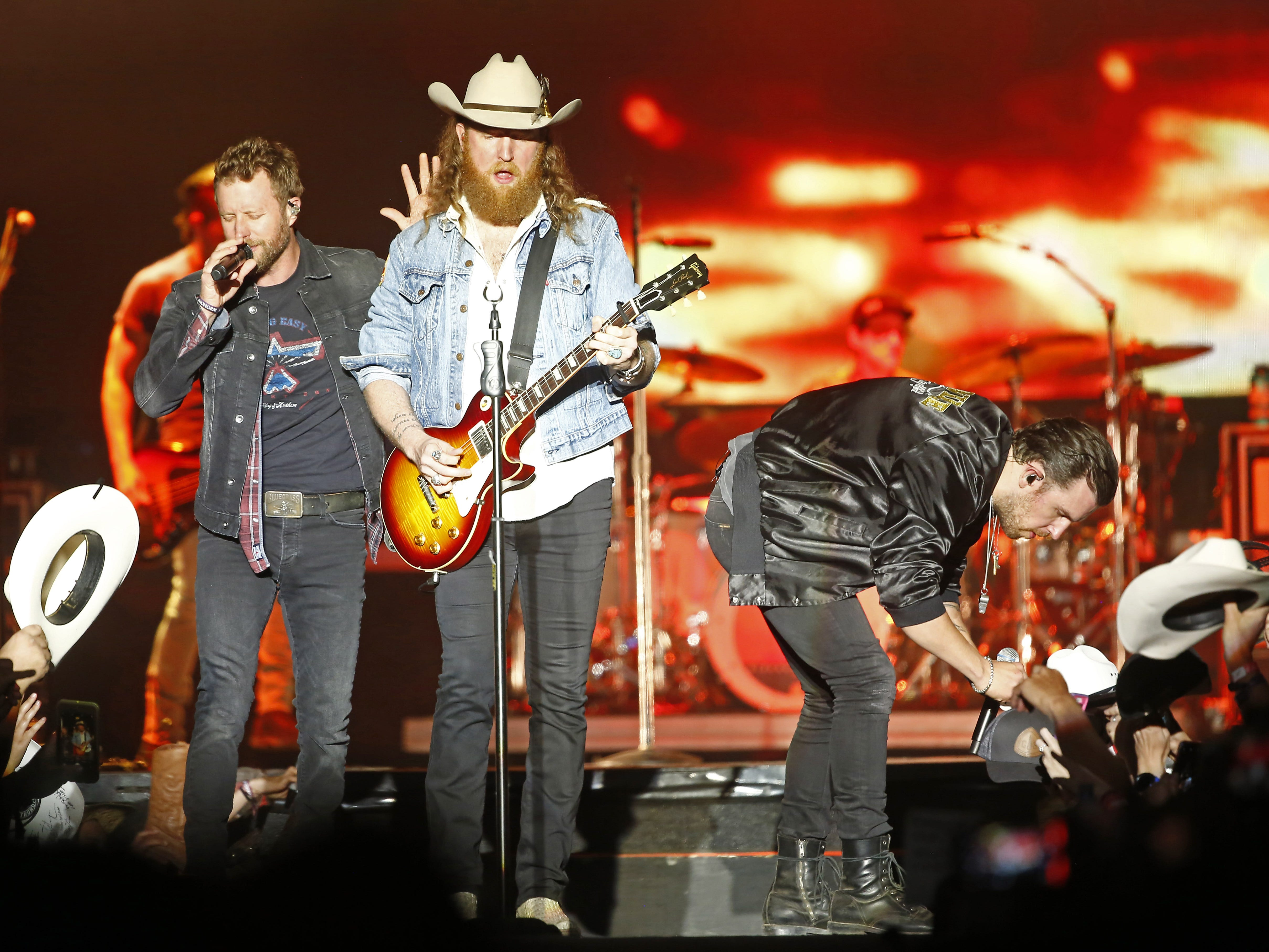 """Dierks Bentley performs """"Burning Man"""" with Brothers Osborne during Country Thunder in Florence, Ariz. on Saturday, April 13, 2019."""