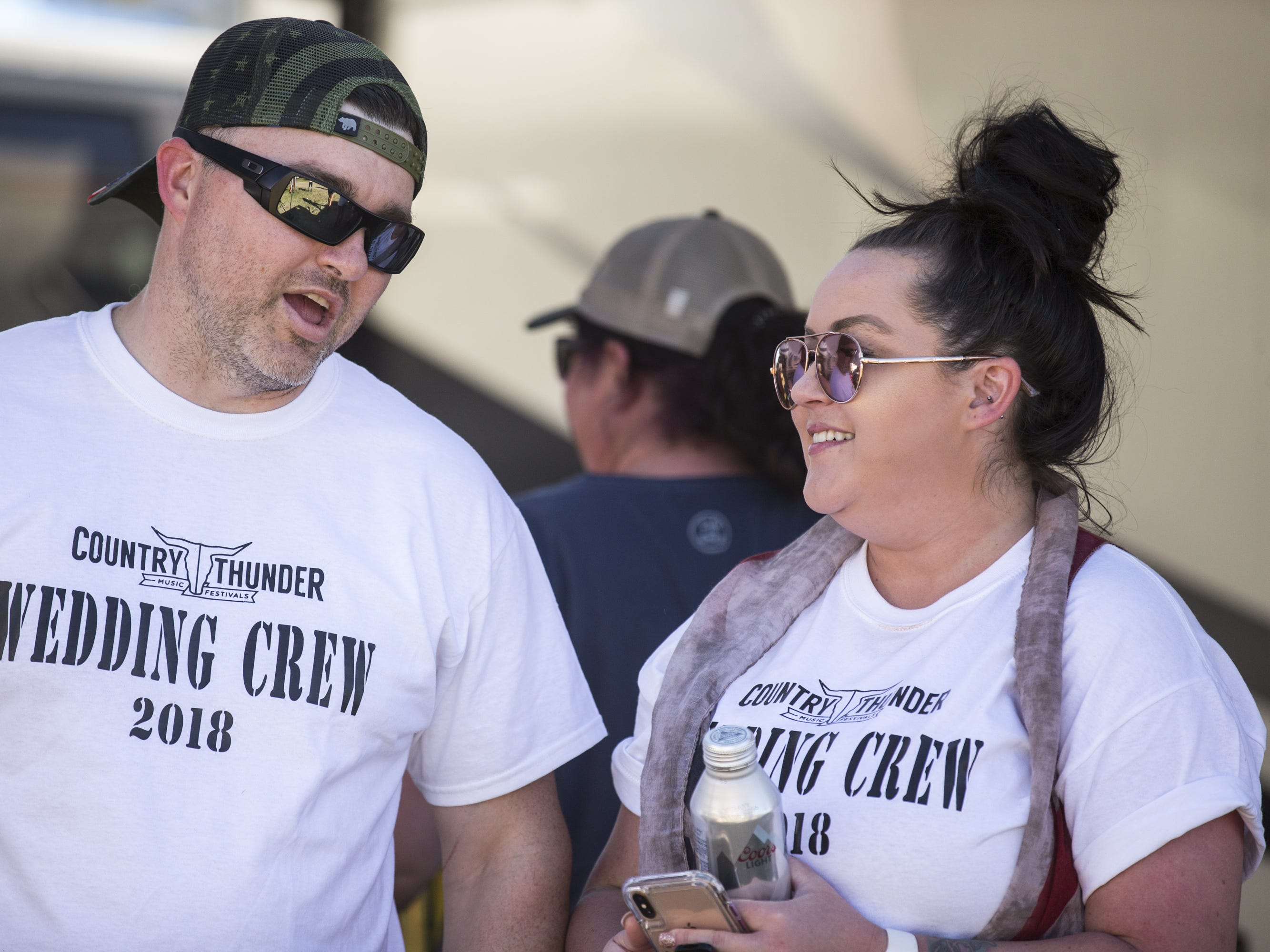 Michael and Mandy Bissey talk at a campsite on Saturday, April 13, 2019, during Day 3 of Country Thunder Arizona in Florence, Ariz. The couple got married at Country Thunder last year.